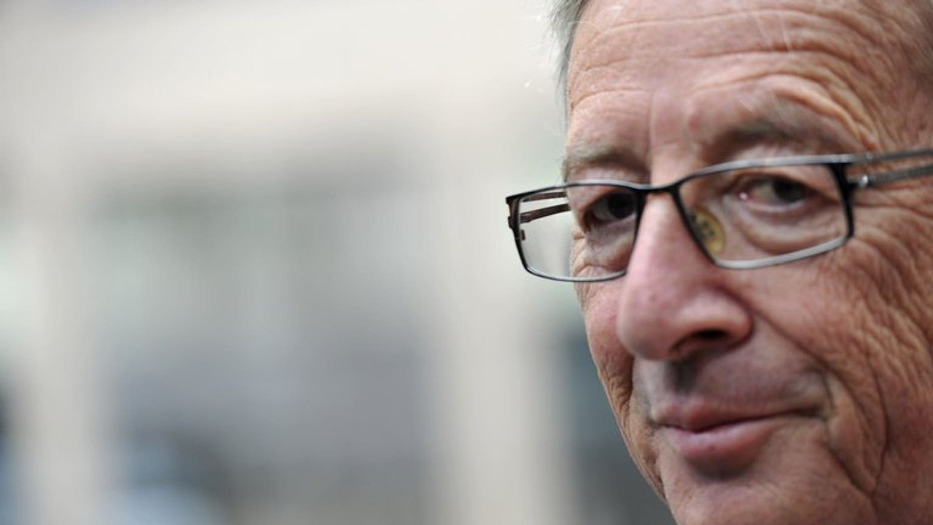 Luxembourg Prime Minister Jean-Claude Juncker, pictured June 27, 2013, said he would step down over a scandal involving the secret services, who were alleged to have indulged in a spate of misconduct on his watch.