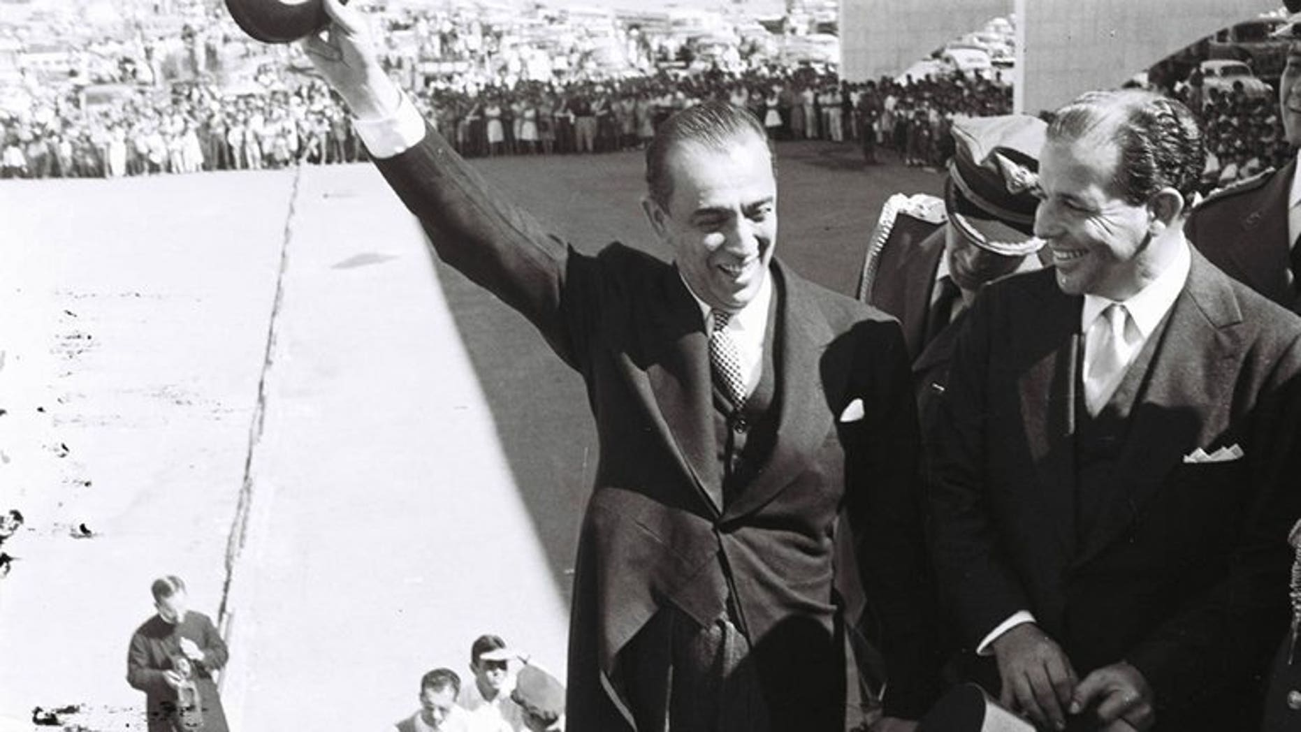 Photo released by the Public Archive of Brasilia's Federal Distric of Brazilian former president (1956-1961) Juscelino Kubitschek (C) next to his vice president Joao Goulart on April 21, 1960. The remains of Goulart, who later became president, will be exhumed to determine whether he was poisoned in the 1970s by rightwing rulers clamping on dissent.