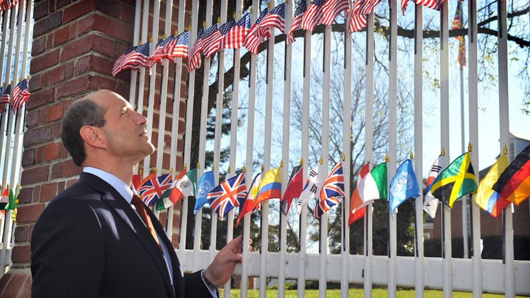 A man has been charged and will face court after a car crashed into the gates of the US embassy in the Australian capital Canberra while ambassador Jeffrey Bleich was at home/