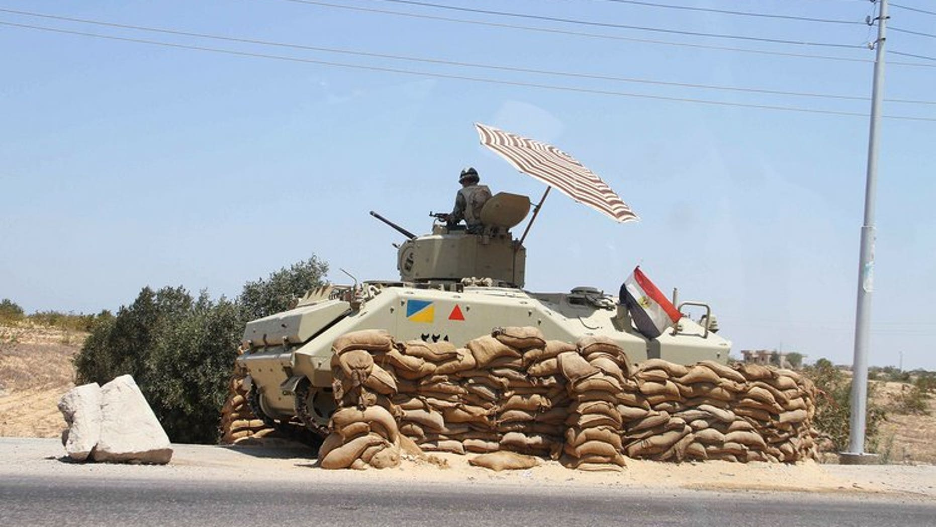 An Egyptian army vehicle in Sinai close to the Rafah border crossing. A Coptic Christian man was found decapitated on Thursday in Egypt's Sinai peninsula five days after he was kidnappped by gunmen, security officials and witnesses told AFP.