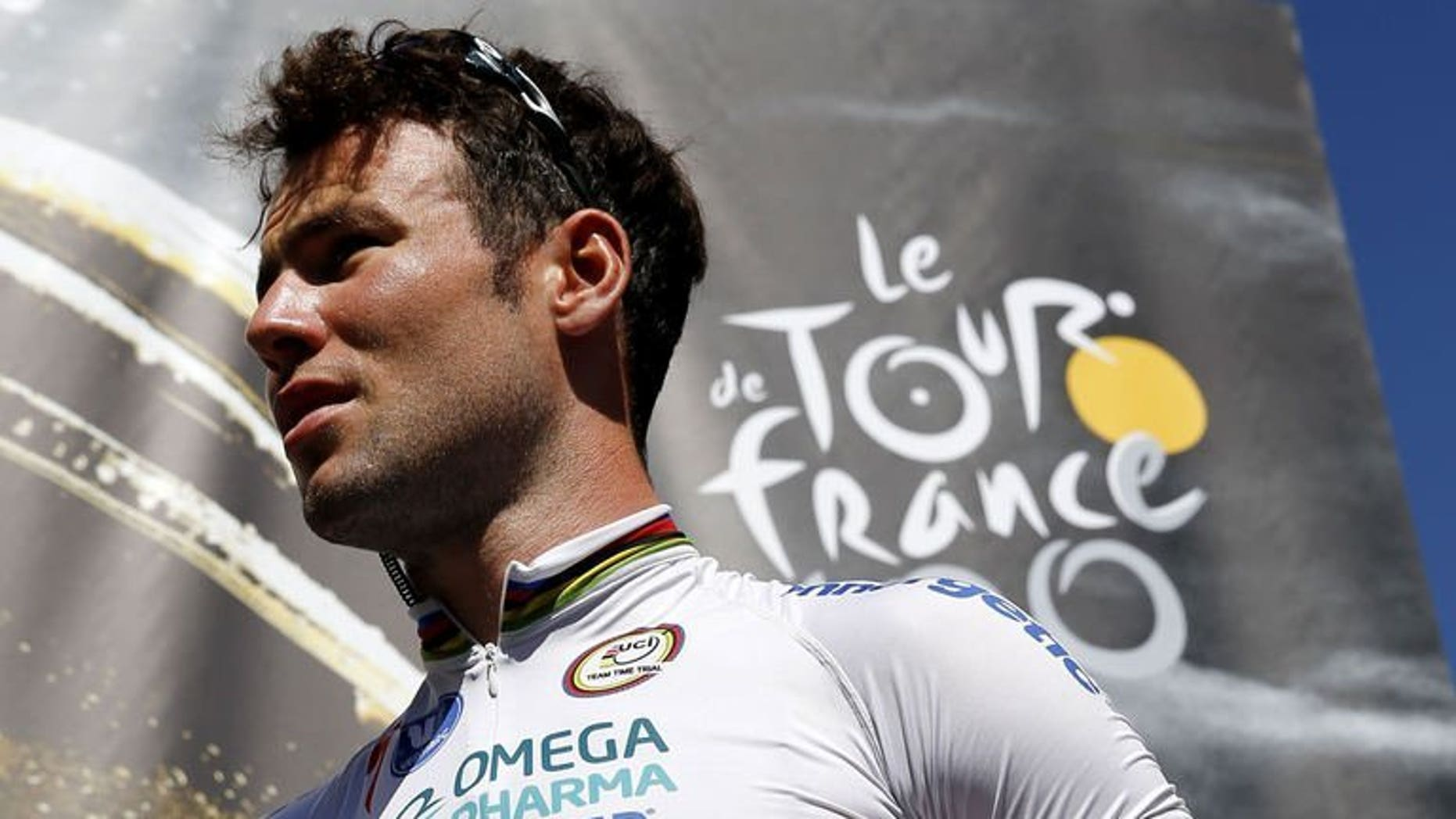 Britain's Mark Cavendish at a ceremony in Castres before the start of the eighth stage of the Tour de France on July 6, 2013 between Castres and Ax 3 Domaines, southwestern France. Cavendish is no longer welcome at the Boxmeer Criterium in the Netherlands, Dutch news agency ANP said on Thursday, reporting that race organisers had withdrawn his name from the list of starters.
