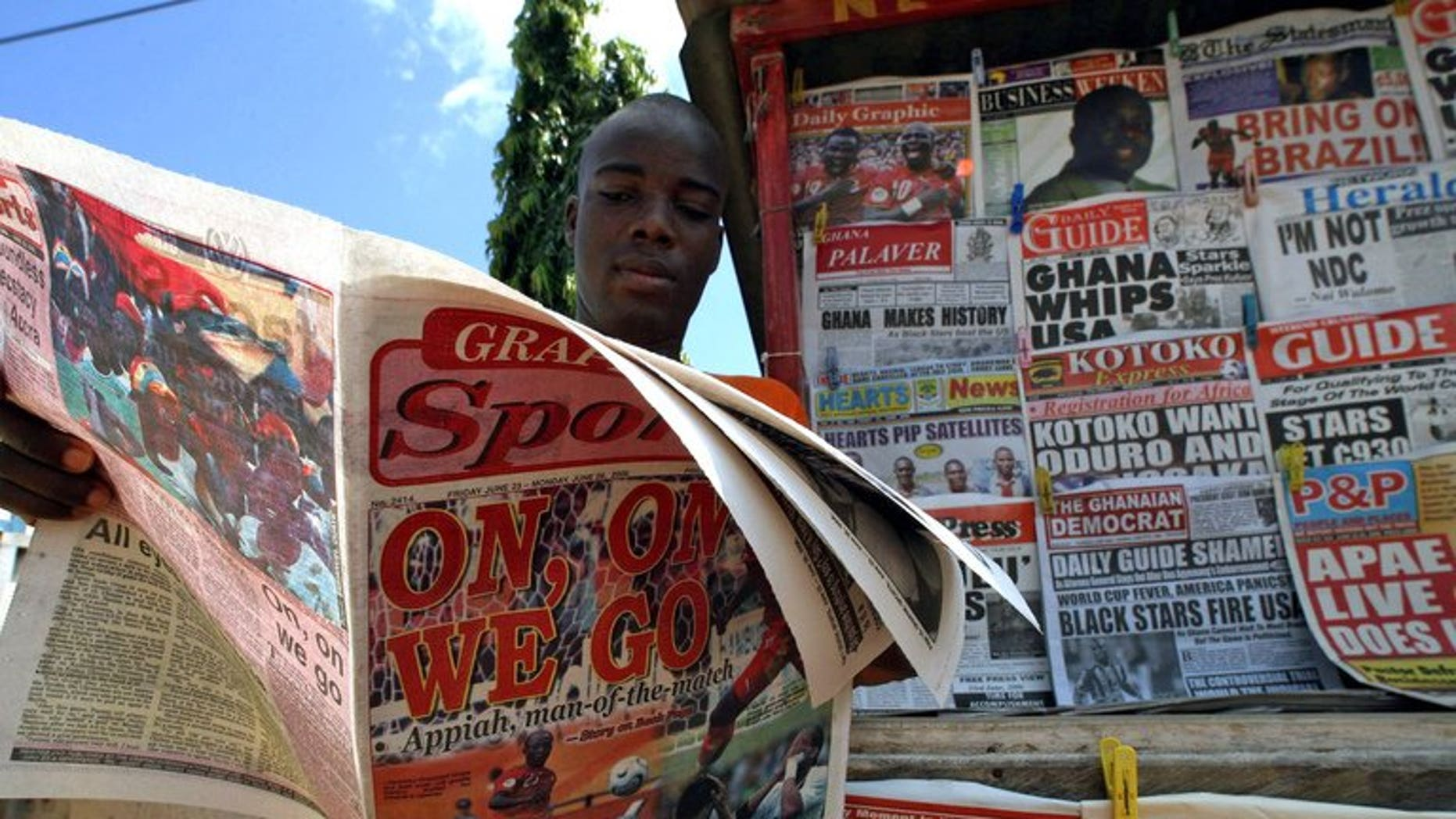 A man reads a newspaper on June 23, 2006 in Accra. A Ghanaian newspaper editor was released Thursday after serving a controversial 10-day jail term ordered by the west African nation's supreme court for criticising the judges' handling of a dispute over last year's presidential election.