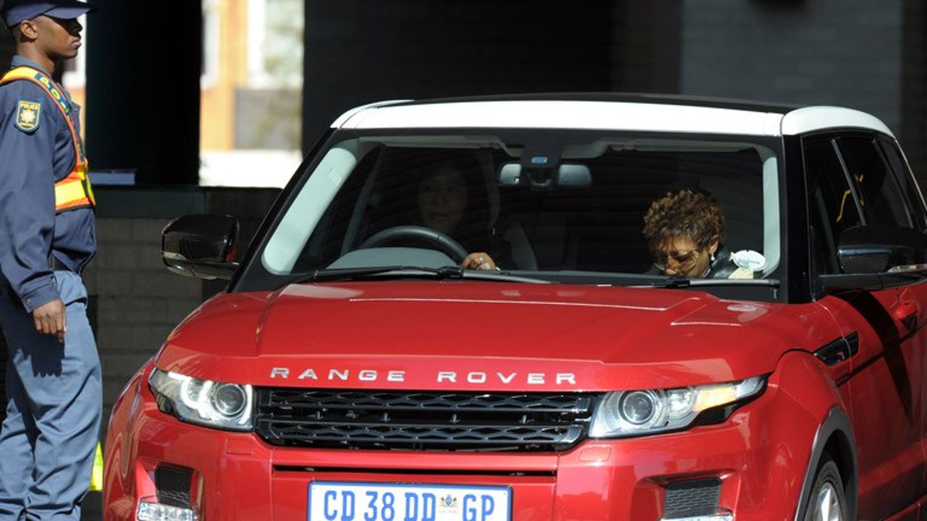 Nelson Mandela's daughters Makaziwe (C) and Zenani Mandela-Dlamini (R) arrive at the Medi Clinic Heart Hospital in Pretoria on June 16, 2013. A date for a court battle involving the control of Mandela's companies has been set for July 29, the South African public broadcaster reported on Thursday.