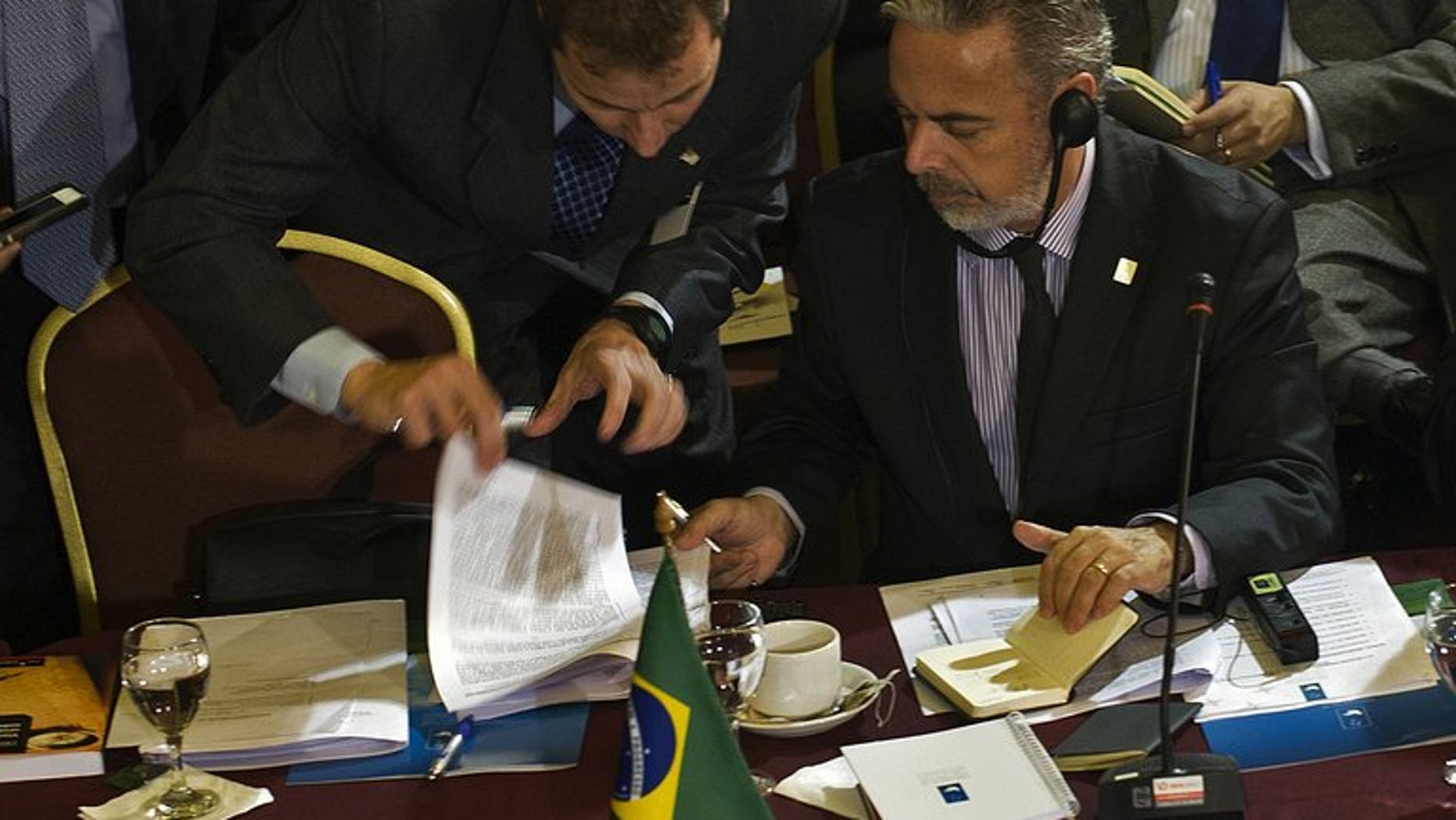 Brazil's Foreign Minister Antonio Patritota listens to an assistant during a Mercosur meeting in Montevideo on July 11, 2013. Leaders of the South American trade bloc that includes Brazil and Venezuela meet Friday for a summit that will focus on allegations of US spying that have outraged US allies and rivals alike.