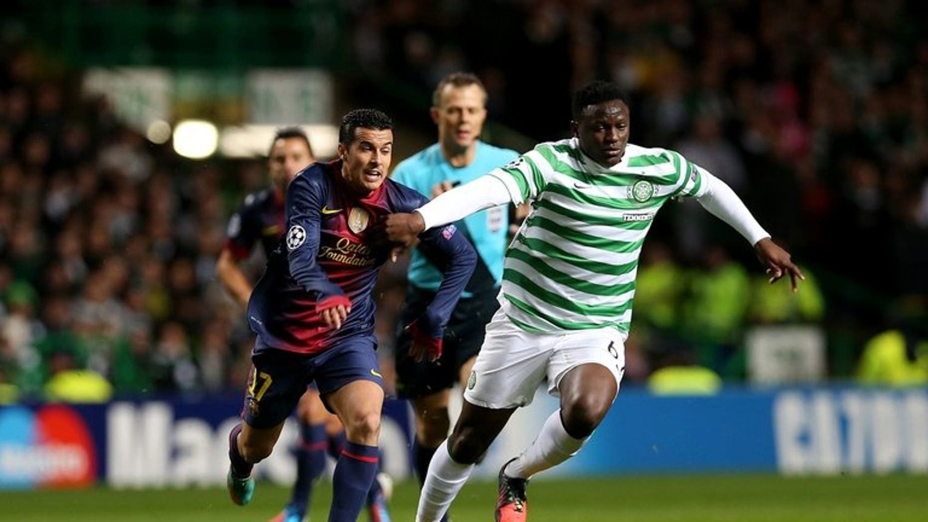 Victor Wanyama fends off Barcelona's Pedro Rodriguez in a Champions League game in Glasgow last November. Kenyans on Friday hailed national football team skipper Victor Wanyama after his move from Scottish champions Celtic to Southampton in the English Premier League.