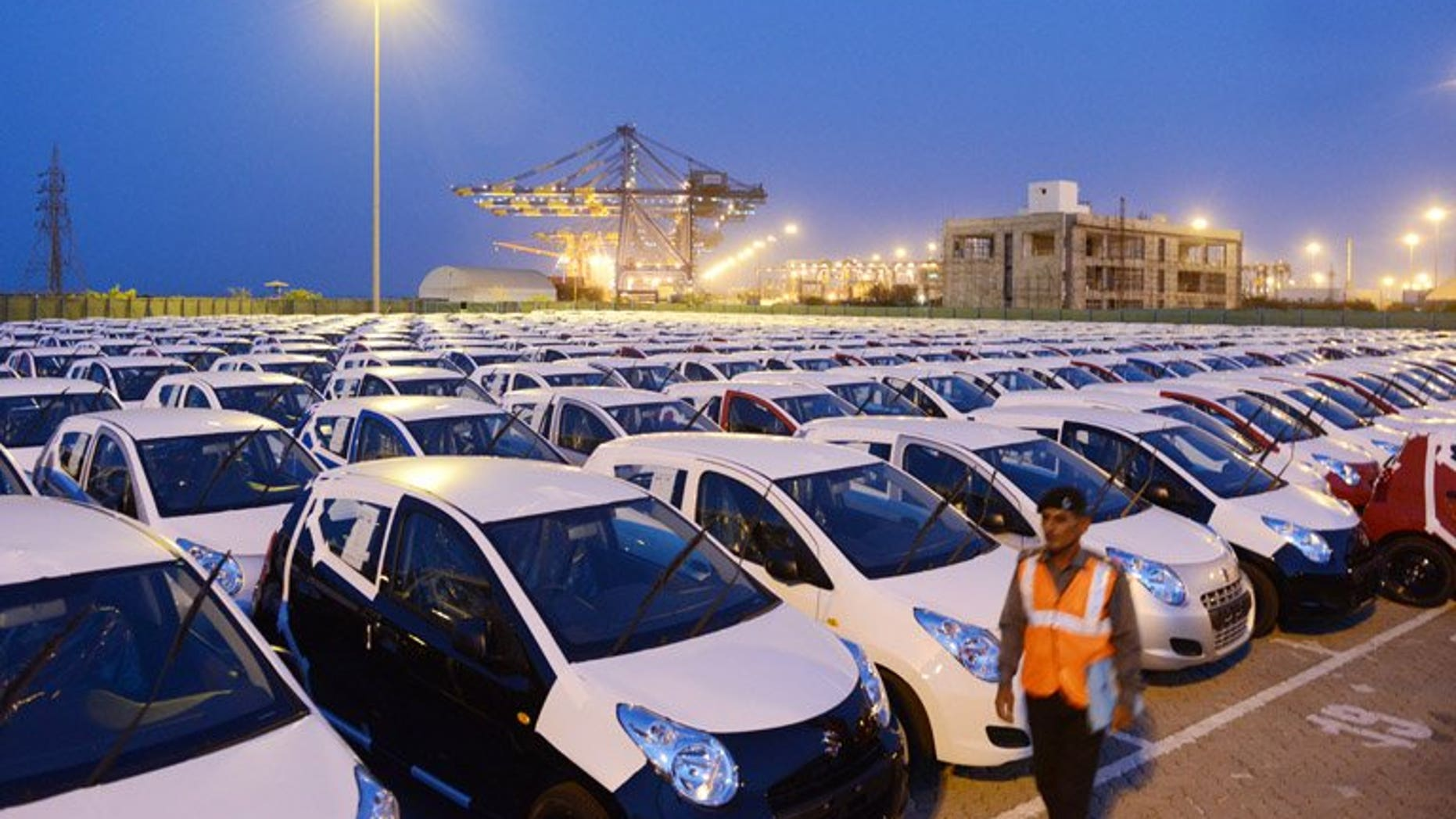 Maruti Suzuki Alto for export are parked in a holding area in Mundra last month. India's car sales slid nine percent in June, marking a record eighth straight month of decline, data showed Friday, as the industry demanded a government package to revive the once booming sector.