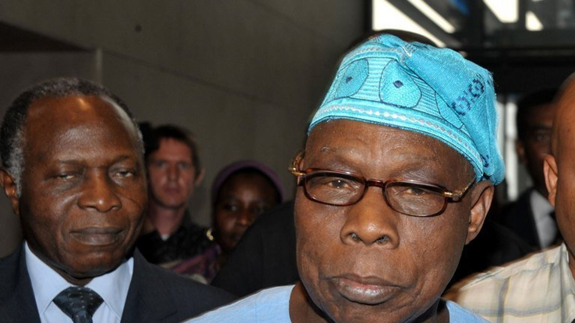 Former Nigerian president and head of a joint mission launched by the African Union (AU) and the Economic Community of West African States (ECOWAS) Olusegun Obasanjo (R) pictured in Dakar on Feburary 25, 2012. Obasanjo will lead a team of 60 African Union monitors to Zimbabwe for the July 31 election, the organisation said Friday.