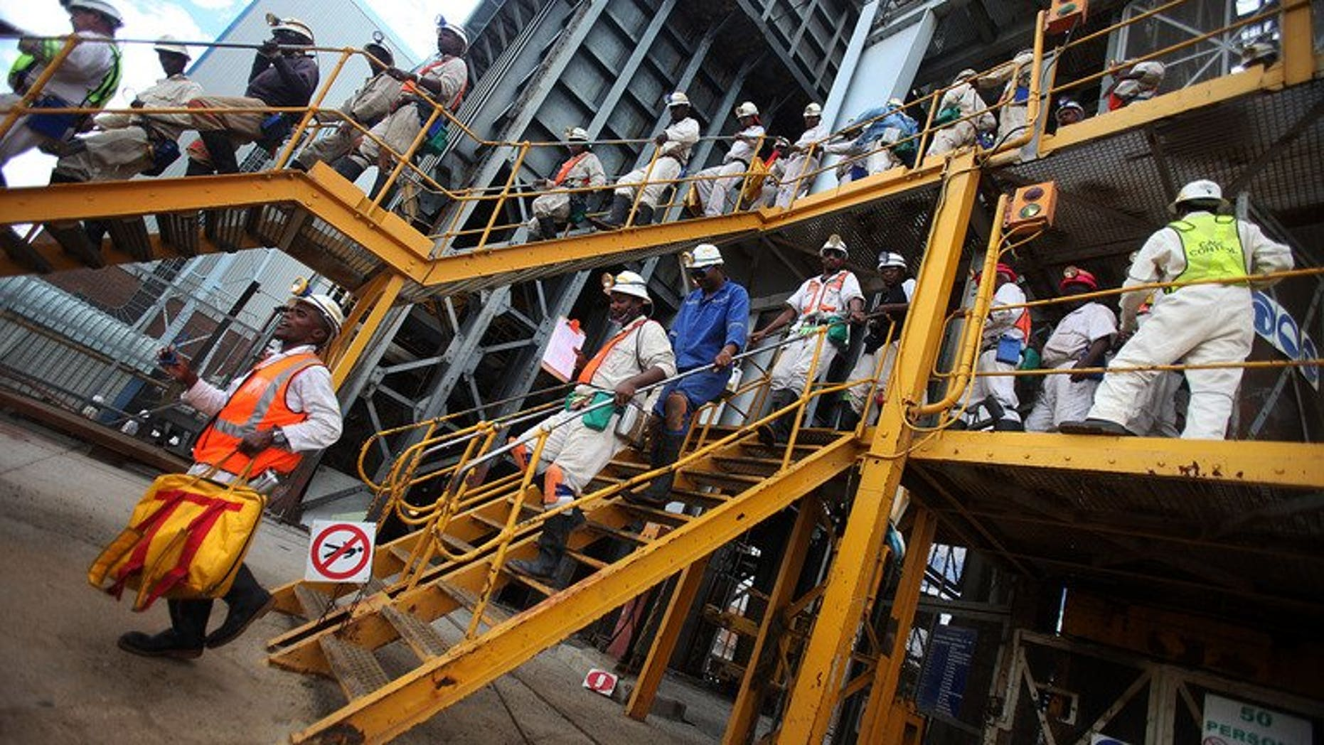 Mine workers leave on January 19, 2011 the 14 Shaft of the Impala Platinum mine in Phokeng. Two of South Africa's leading mining companies on Friday named a hardline union as the largest grouping at some facilities, raising hopes for an end to months of labour unrest.