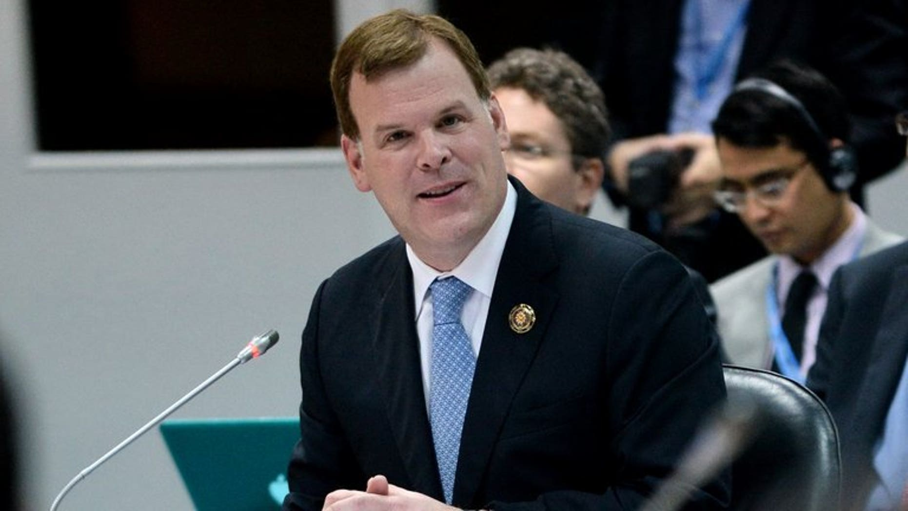 "Canada Foreign Minister John Baird speaks in Brunei's capital Bandar Seri Begawan on July 1, 2013. Canada plans to send ""at least 15"" observers to monitor the opening round of Mali's presidential elections on July 28, Baird said in a statement Friday."
