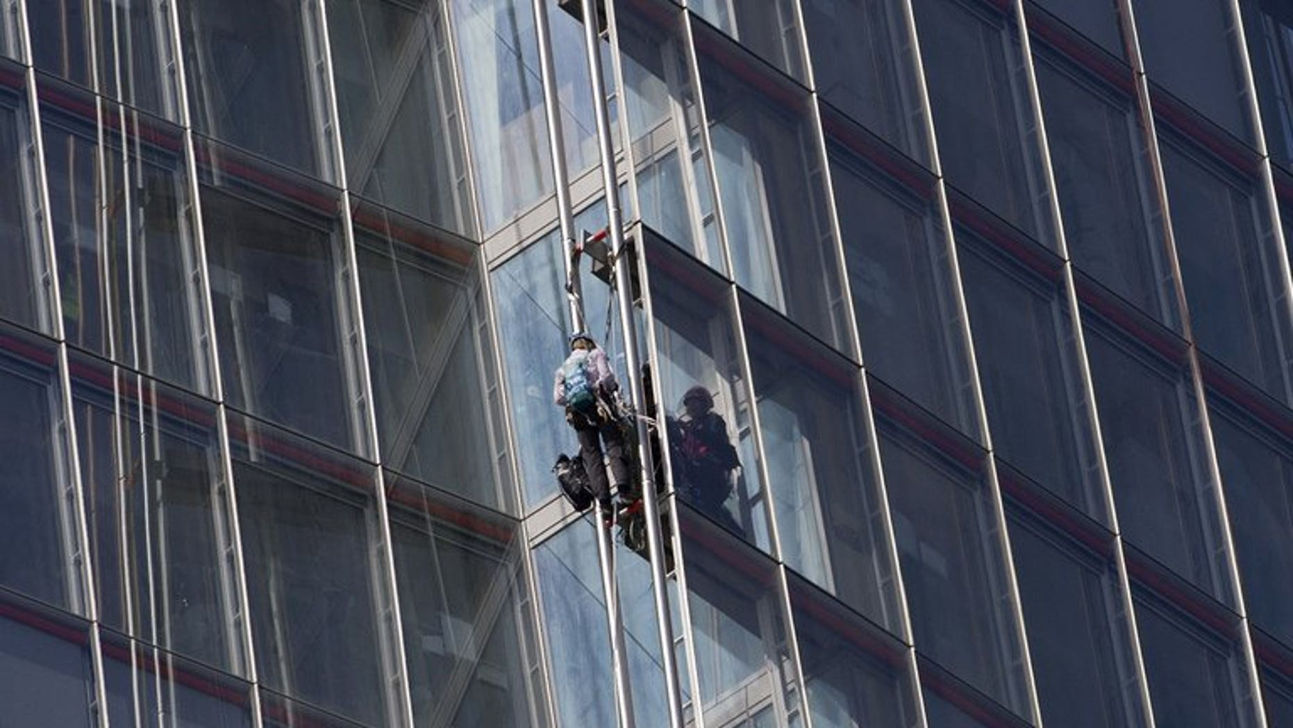 """Greenpeace protesters climb """"The Shard"""" skyscraper in central London on July 11, 2013 during a demonstration against oil exploration in the Arctic."""