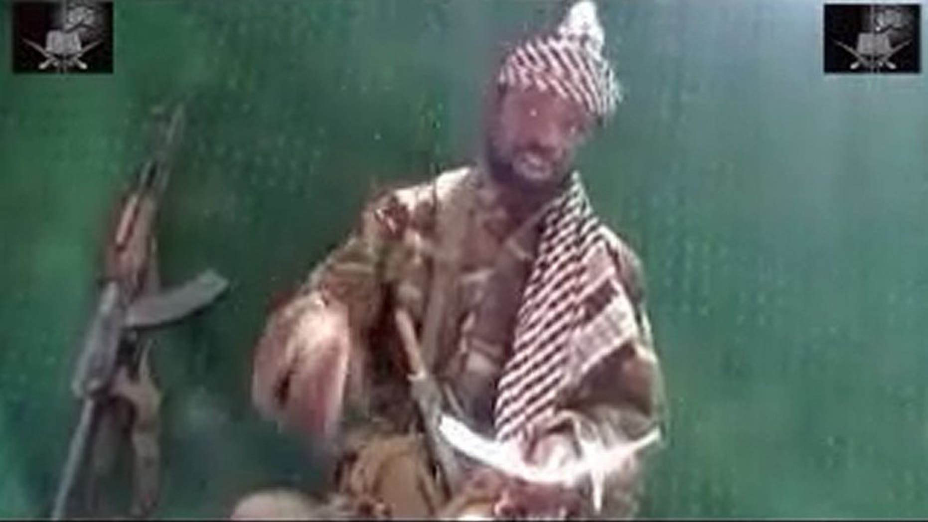 Picture taken May 29, 2013 from a video obtained by AFP shows the leader of the Islamist extremist group Boko Haram Abubakar Shekau. In a ten-minute video delivered to AFP Saturday, Shekau said he supported a July 6 attack on a school that killed 42 people, but did not claim responsibility for the massacre,