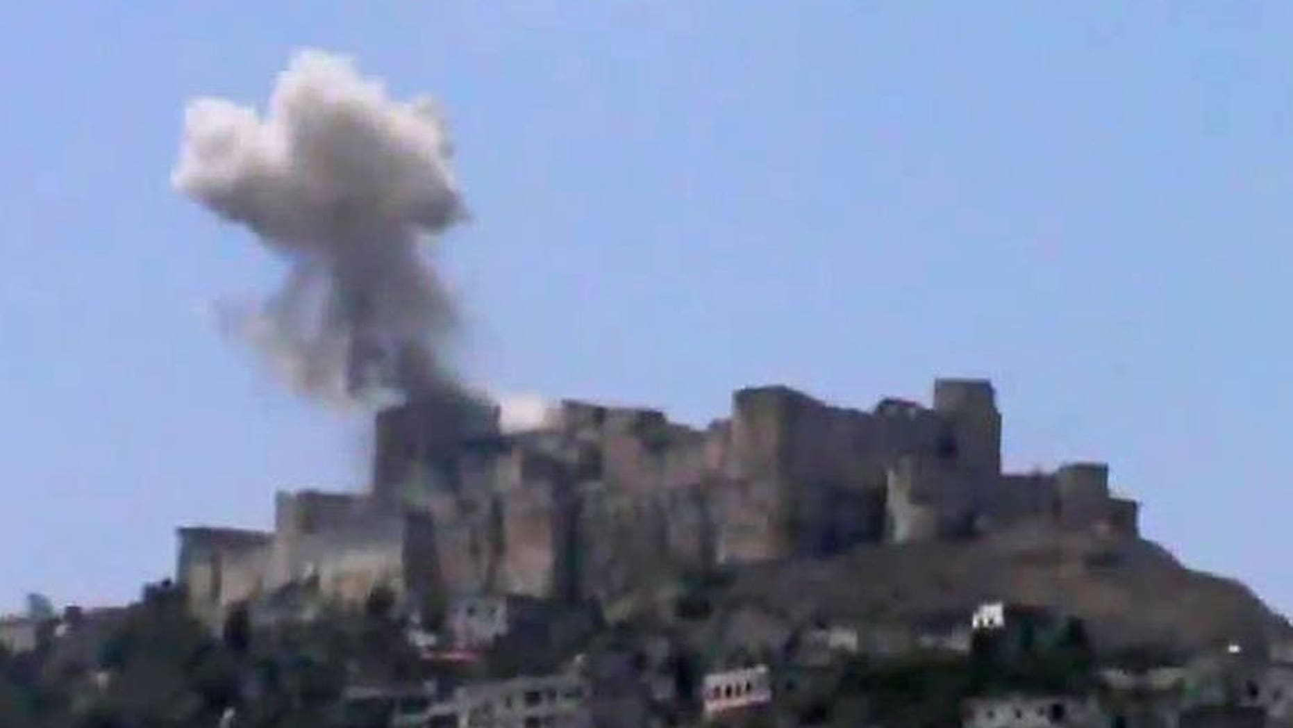 An image grab taken from a video uploaded on YouTube on July 12, 2013 shows smoke billowing from Syria's famed Krak des Chevaliers castle in central Homs province. AFP is using pictures from alternative sources. An air raid has damaged one of the fortress's towers, according to footage shot by activists.