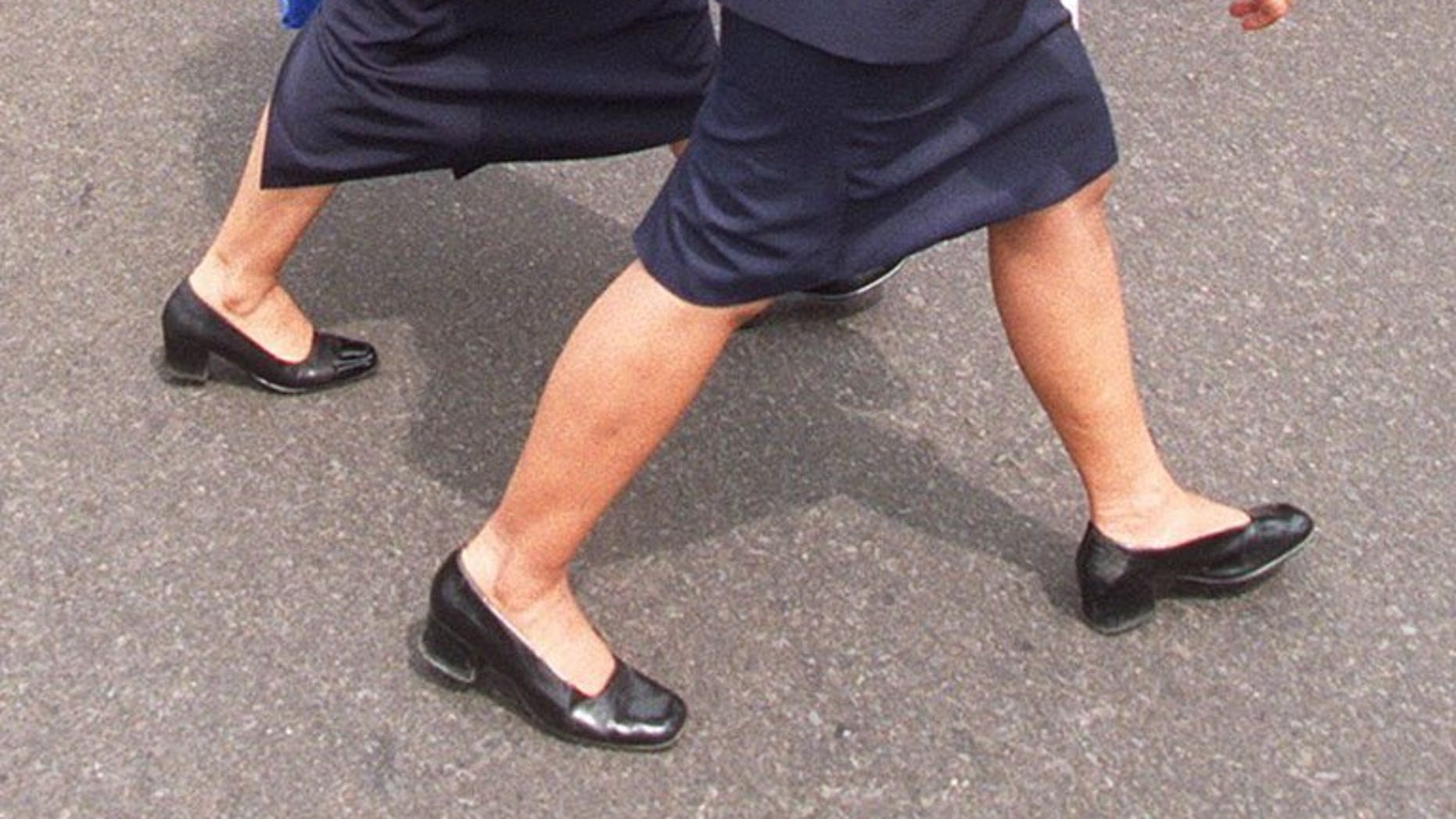 Two Indonesian secretaries walk through the centre of Jakarta. The governor of an Indonesian province has ordered his top staff to replace their female secretaries with men following a string of extra-marital affairs.