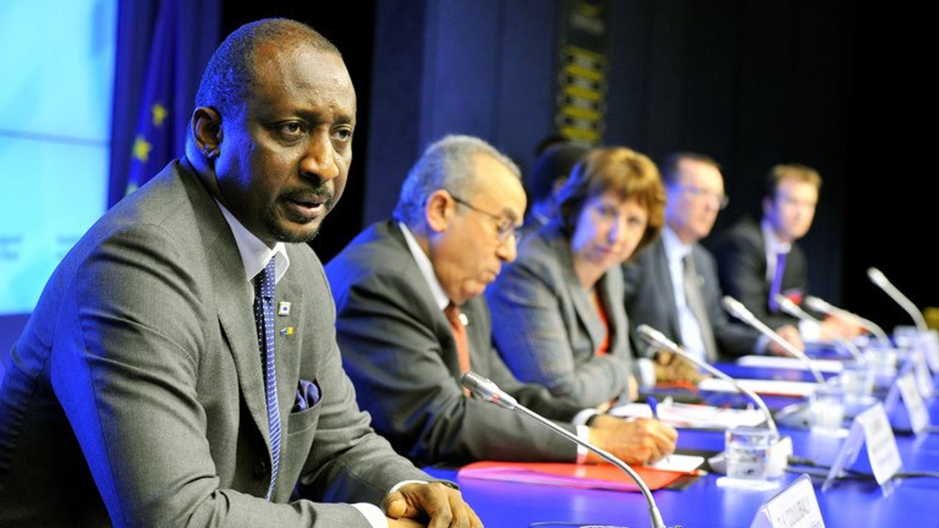 Malian Foreign minister Tieman Coulibaly (left), pictured on February 5, 2013 at the EU headquarters in Brussels, says the country will push ahead with a presidential vote this month and warned rebel groups in the north against opposing the election.