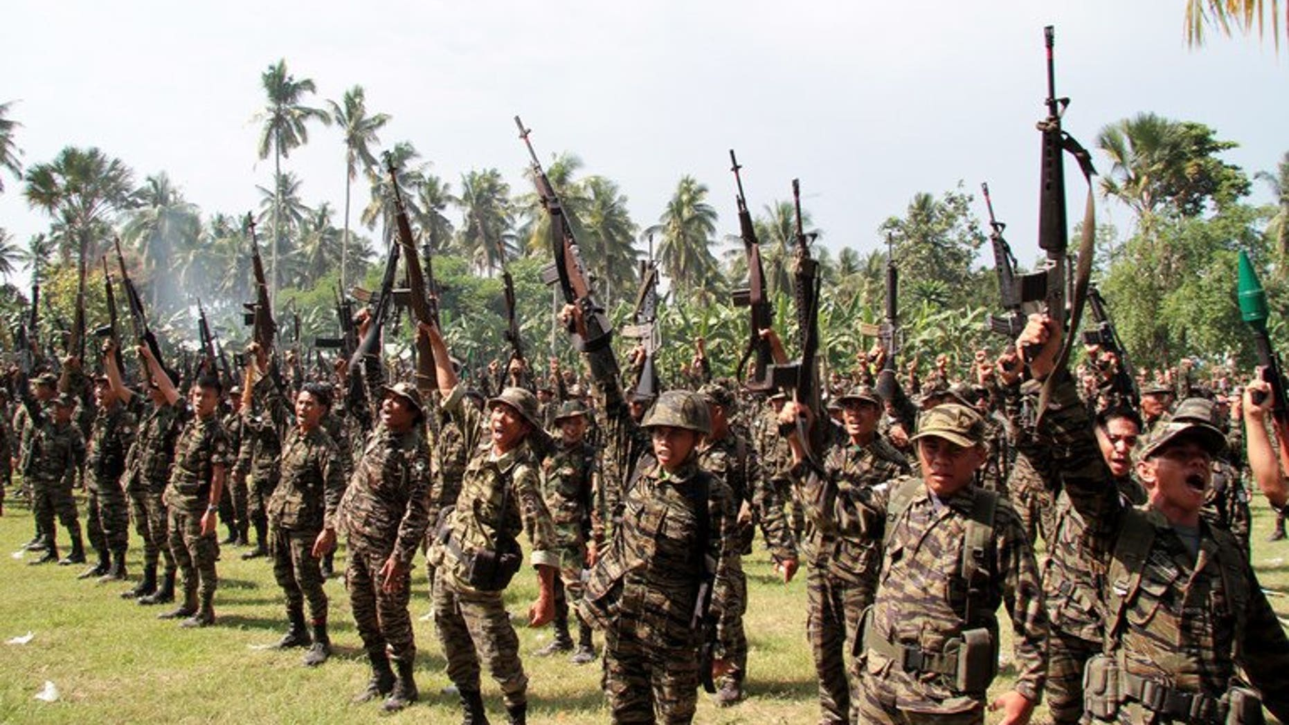 Members of the Moro Islamic Liberation Front hold a ceremony on the southern Philippine island of Mindanao on October 15, 2012. The Philippine government has resolved a key hurdle in peace talks with the Muslim rebels, it announced early Sunday, bringing it closer to ending an insurgency that has claimed tens of thousands of lives.