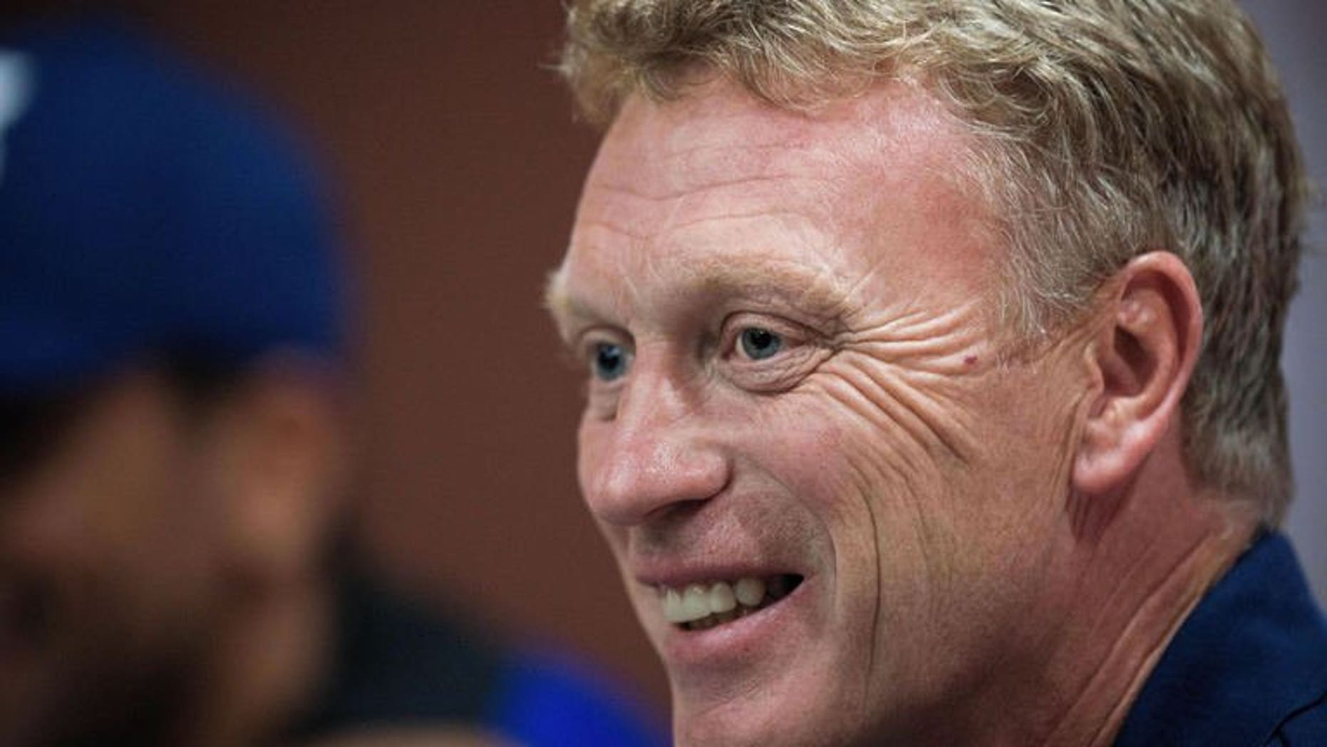 Manchester United football manager David Moyes speaks to the media in Bangkok on July 12, 2013. Moyes says he still needs to come to terms with the level of scrutiny he faces as manager of one of the world's biggest football clubs.