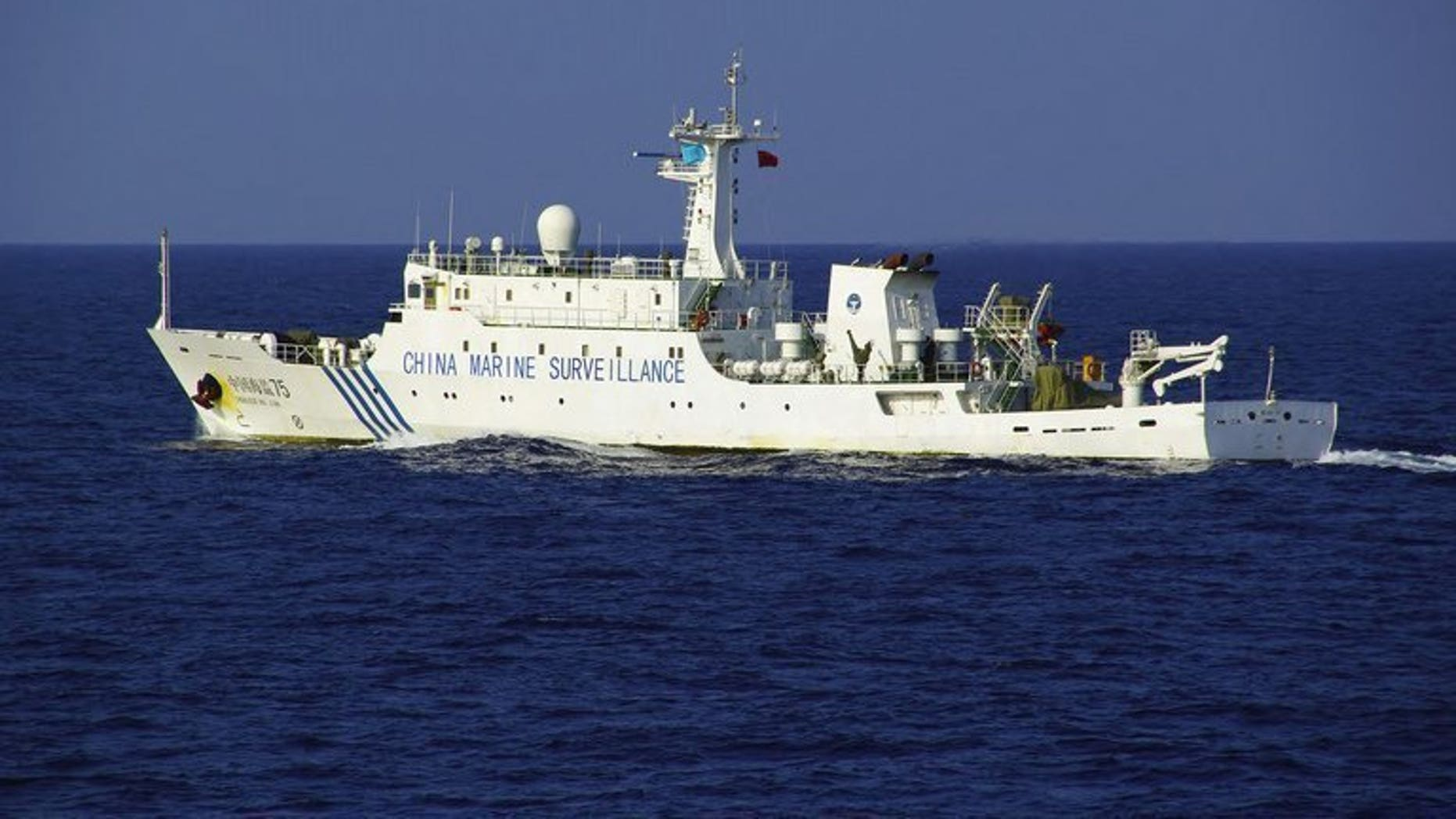 A Chinese maritime surveillance ship sails near a group of disputed islands in the East China Sea, October 25, 2012. A Chinese naval fleet has been spotted sailing for the first time through an international strait between northern Japan and Russia's far east, according to the Japanese defence ministry.