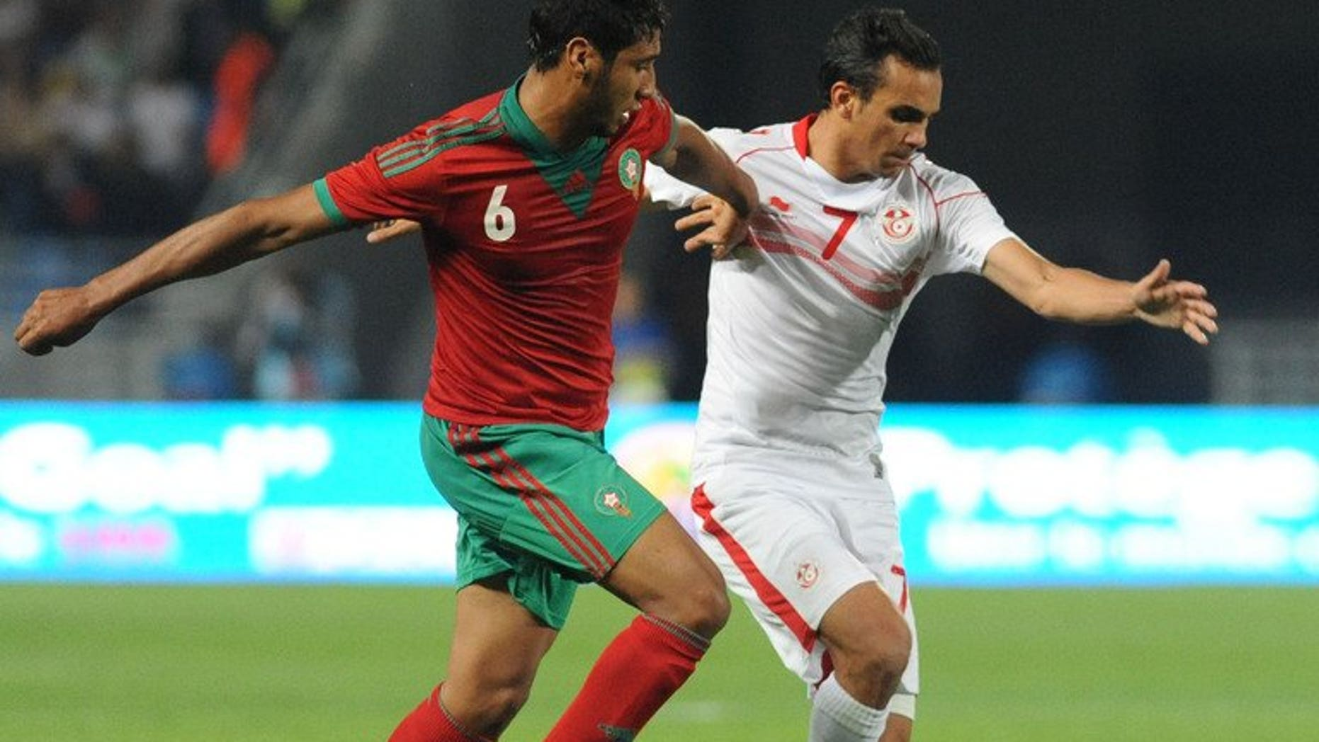 Morocco's Benjelloun Abdessamad (left) vies for the ball with Tunisia's Mhirsi Driss during the African Nations Championship qualifying match on July 13, 2013. Holders Tunisia were eliminated in the first qualifying round after drawing 0-0.