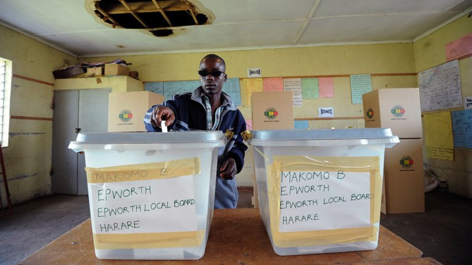 Zimbabweans cast their vote in a referendum on a new constitution in Epwath on March 16, 2013. Zimbabwe security forces have begun voting in an early election, with delays reported due to the lack of ballot papers just over two weeks before crucial presidential polls.