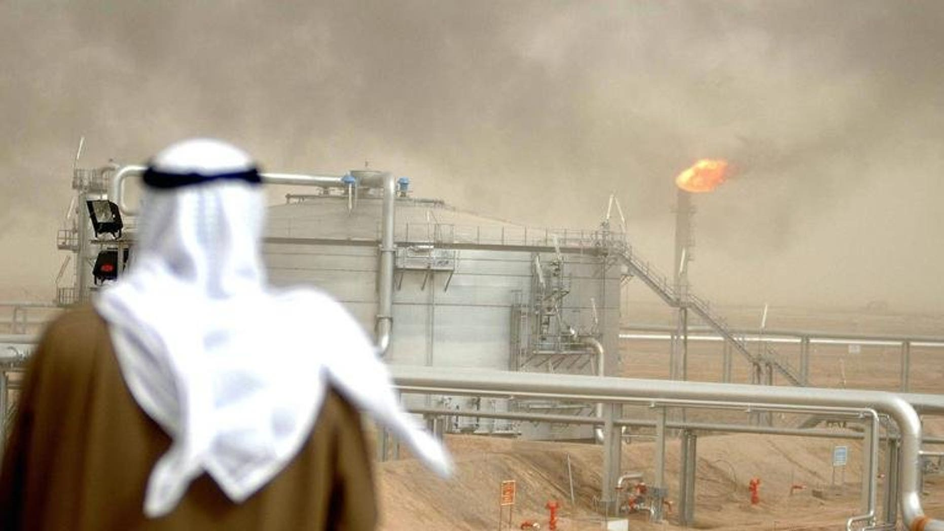 An employee of the Kuwait Oil Company (KOC) looks at the al-Rawdatain refinery. Kuwait has delivered crude oil and diesel worth $200 million to Egypt as part of a $4-billion aid package to bolster its faltering economy, according to local newspaper reports.