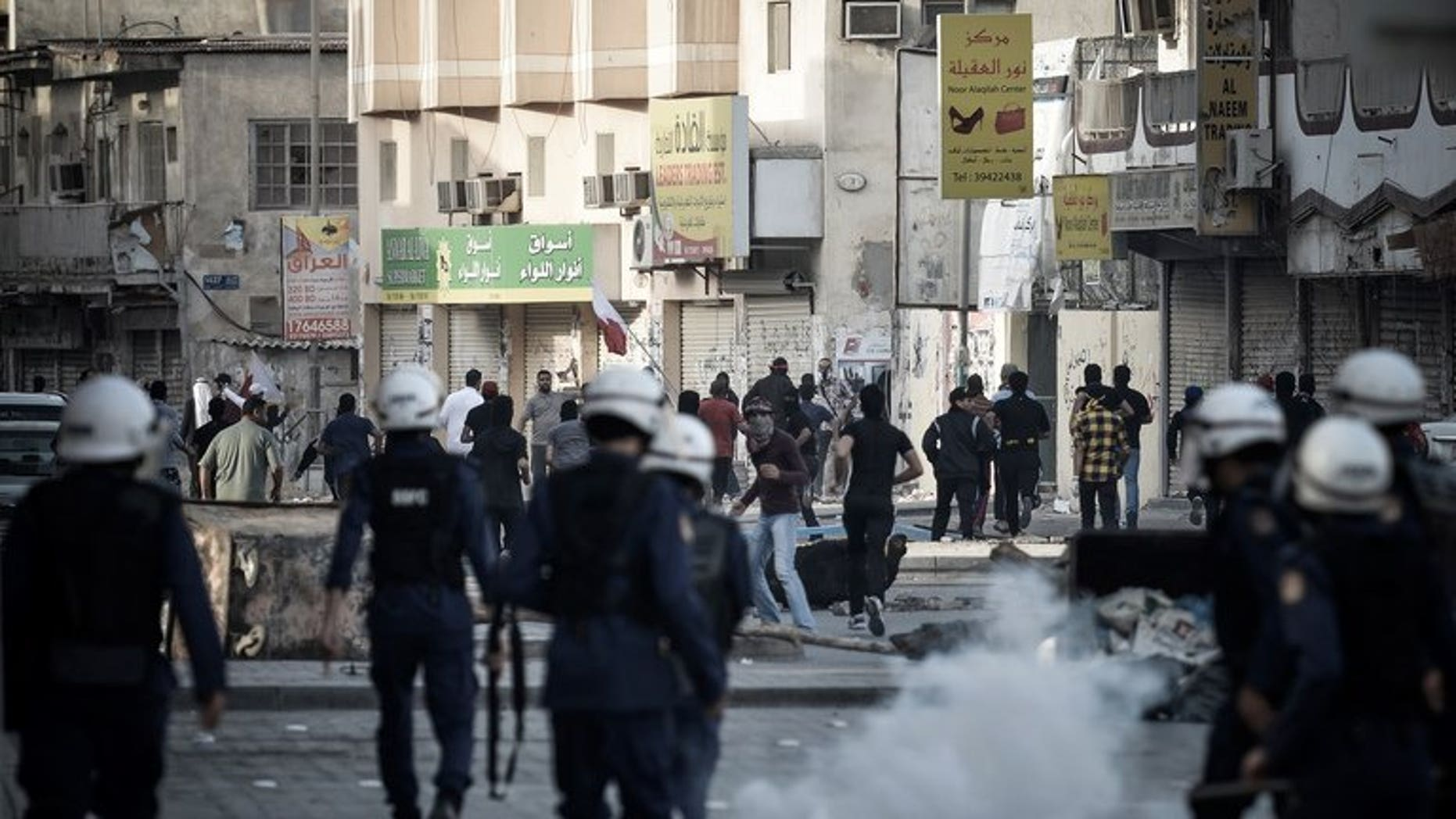Bahraini riot police disperse protesters during a demonstration in Daih, on February 22, 2013. A home-made bomb has wounded four Bahraini policemen outside a Shiite village, the interior ministry said in the latest unrest to rock the Sunni-ruled Shiite-majority Gulf state.