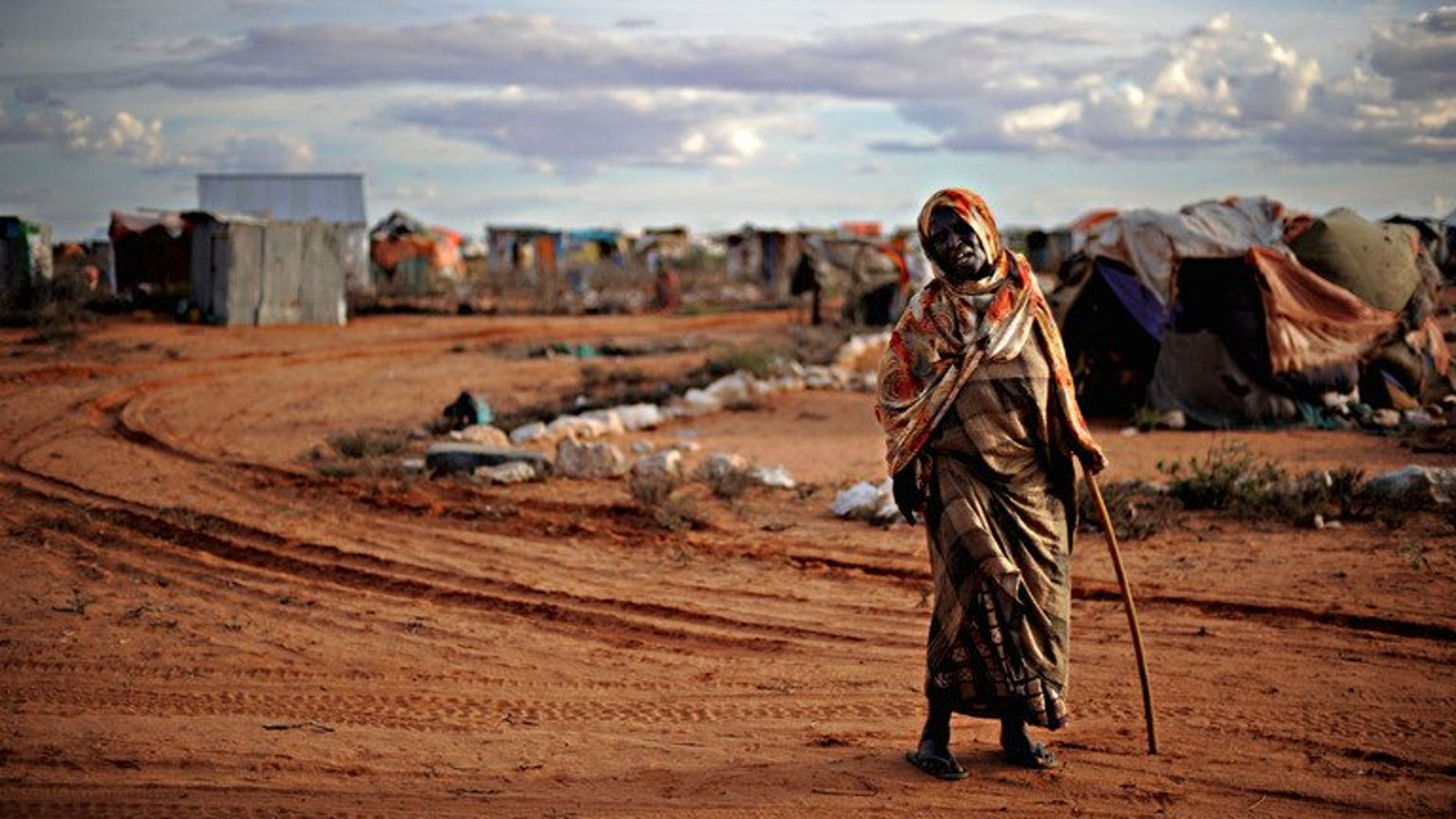 An elderly woman displaced by violence walks in a refugee camp in the northern breakaway state of Puntland on October 17, 2009. Somalia's semi-autonomous northern region has suspended long-awaited local elections, its government said, saying the risk of violence was too great to hold them.
