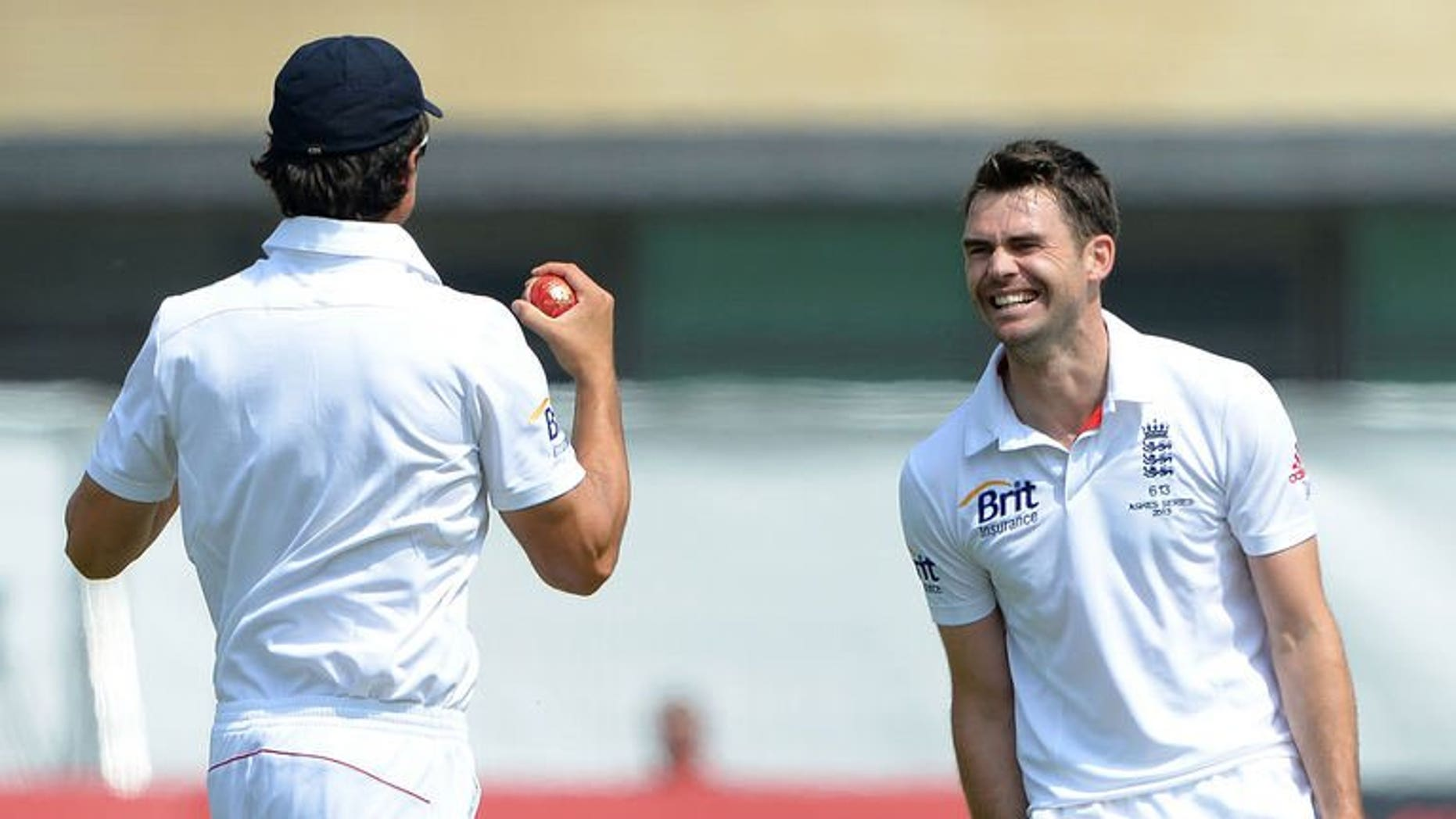 England's James Anderson (R) celebrates with England's Alastair Cook after claiming the wicket of Australia's Mitchell Starc during the fifth day of the first Ashes cricket test match between England and Australia at Trent Bridge in Nottingham, central England, on July 14, 2013.