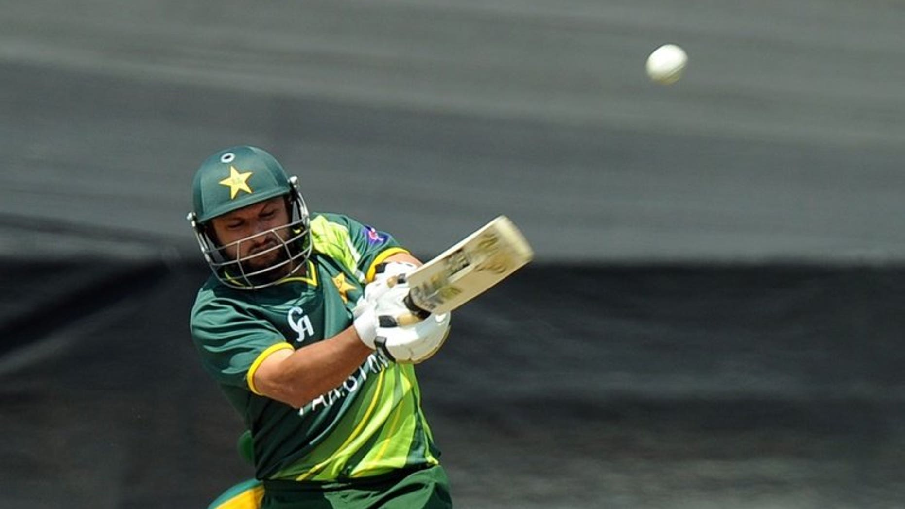 Pakistan's cricketer Shahid Afridi hits the ball in Benoni at Willowmoore Park on March 24, 2013. Hugely contrasting half-centuries by Afridi and Misbah-ul-Haq rescued Pakistan from a perilous position as they reached 224 for nine against the West Indies in the first one-day international.