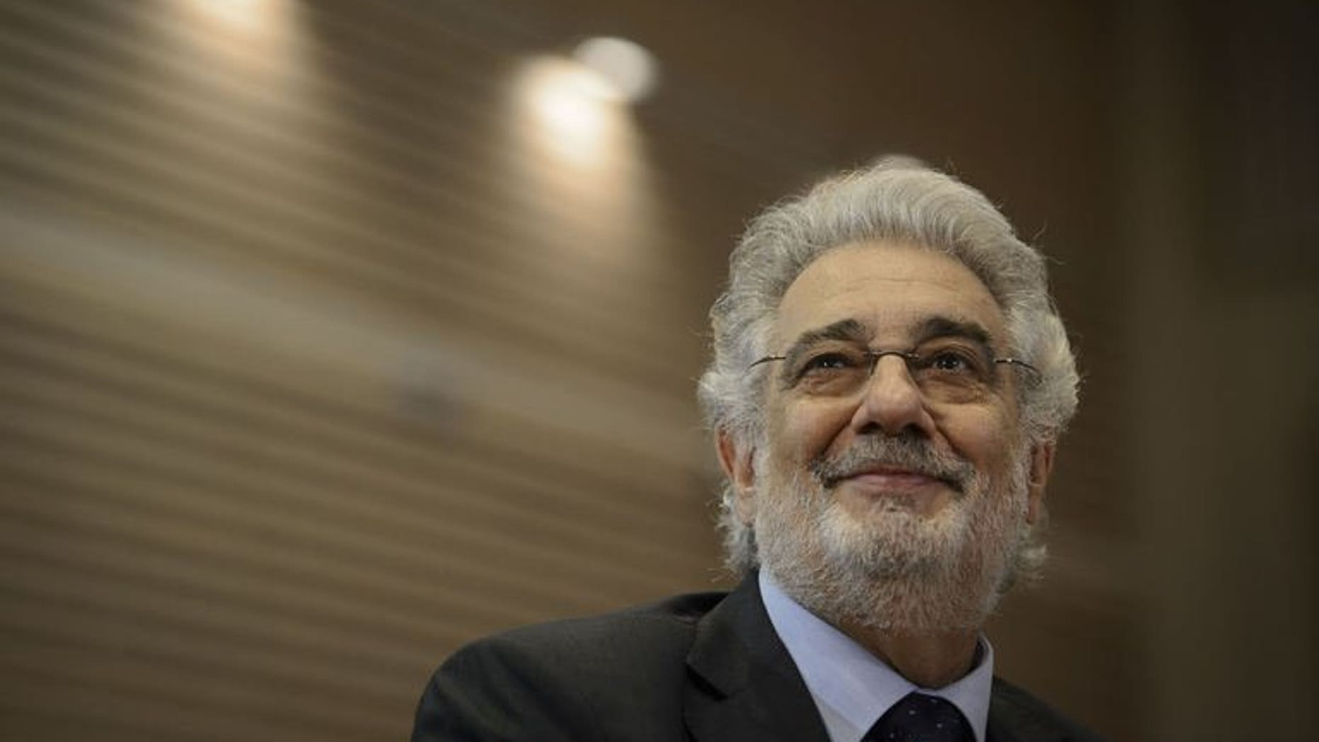 """Spanish tenor Placido Domingo gives a press conference at the Royal Theater in Madrid on July 14, 2013, before attending a dress rehearsal of Daniel Catan's """"Il Postino"""". Domingo said on Sunday that he was feeling well after treatment for a blockage in his lung, as his doctor said the tenor would make a full recovery."""