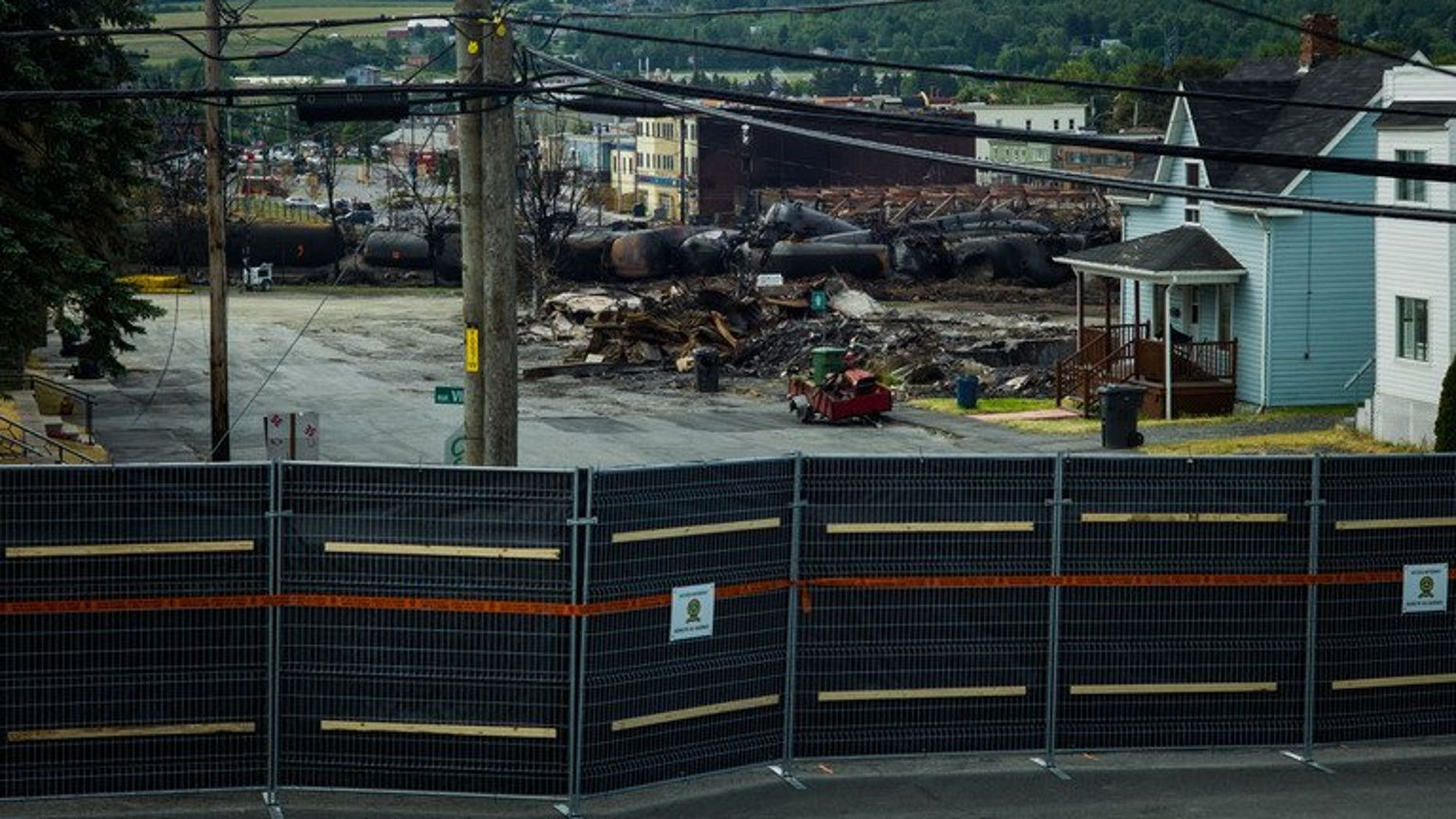 "The ""red zone"" crash site, on July 14, 2013 in Lac-Megantic, Quebec, Canada. Two more bodies were found Sunday in downtown Lac-Megantic, the Quebec town devastated when an oil tanker train derailed and exploded, bringing the body count to 35 of the 50 presumed dead."