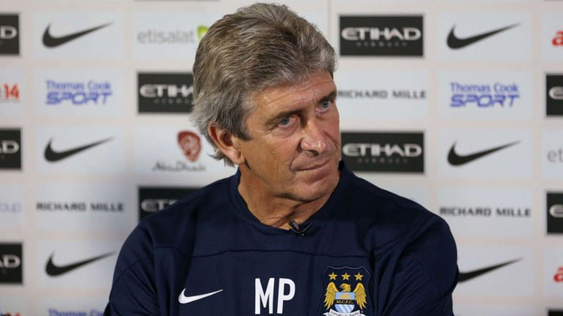 Manchester City's new Chilean manager Manuel Pellegrini attends a press conference at the team's Carrington Training Ground, in Carrington on July 10, 2013. Pellegrini is sure he will add to his attacking options before the start of the new season.