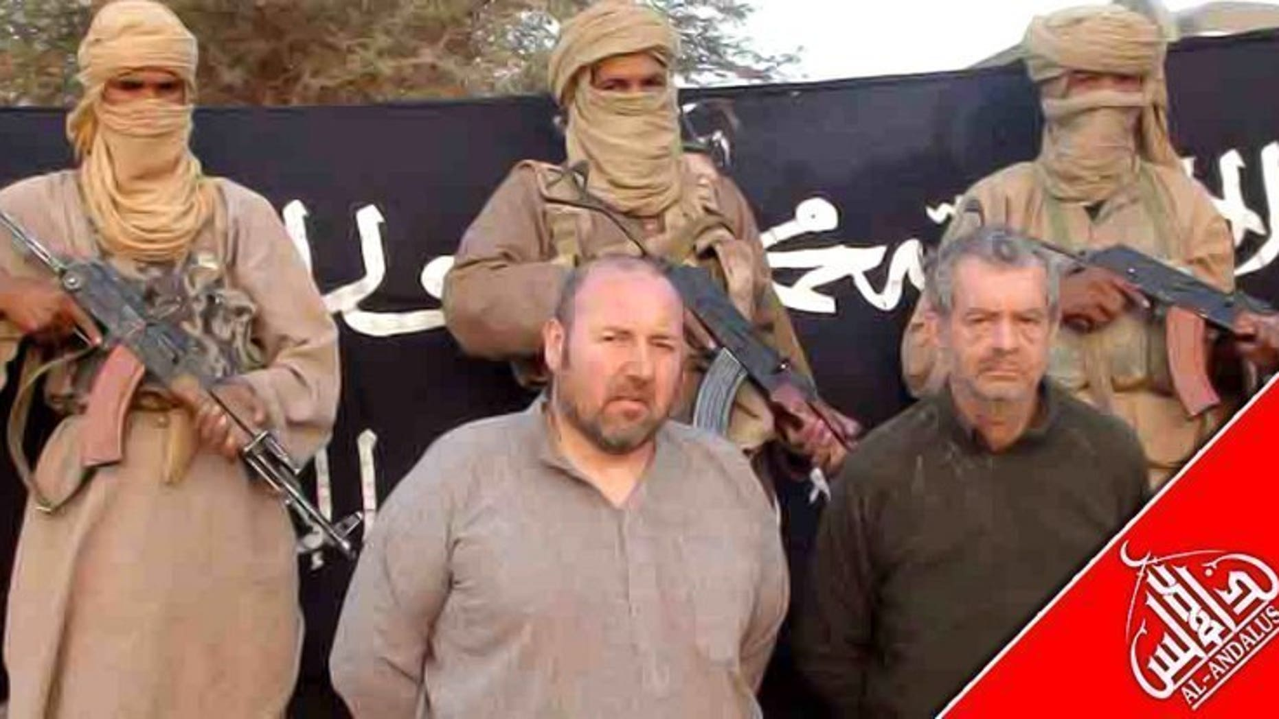 "French nationals Philippe Verdon (front R) and Serge Lazarevic (C) are held by Al-Qaeda in the Islamic Maghreb (AQIM) at an undisclosed location in an undated image released by Al-Andalus, the media branch of AQIM. President Francois Hollande said Monday there is a ""very strong"" chance that a body found in northern Mali is that of Verdon and vowed the killing would not go unpunished."
