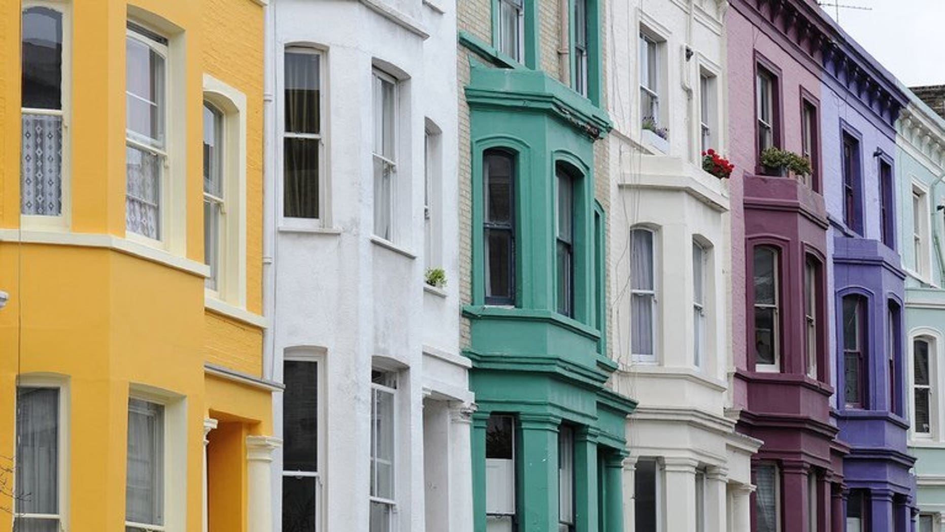 """A row of terraced houses is pictured in west London, on August 30, 2011. One third of Britain is """"effectively off limits"""" to families on low incomes because of the high cost of rented housing, according to a new report."""