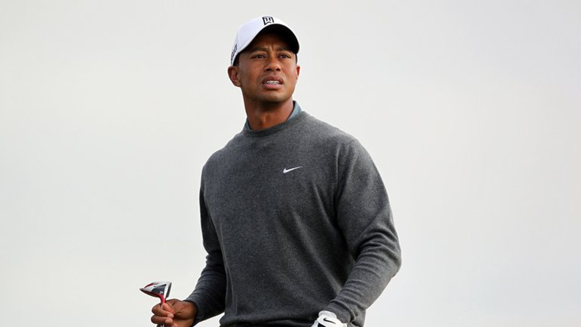 US golfer Tiger Woods watches his shot from the 17th tee during a practice round for the 2013 British Open Golf Championship at Muirfield Golf Course in Gullane, eastern Scotland on July 15, 2013. Woods will join Ulsterman Graeme McDowell and South African Louis Oosthuizen for Thursday's first round of the British Open.