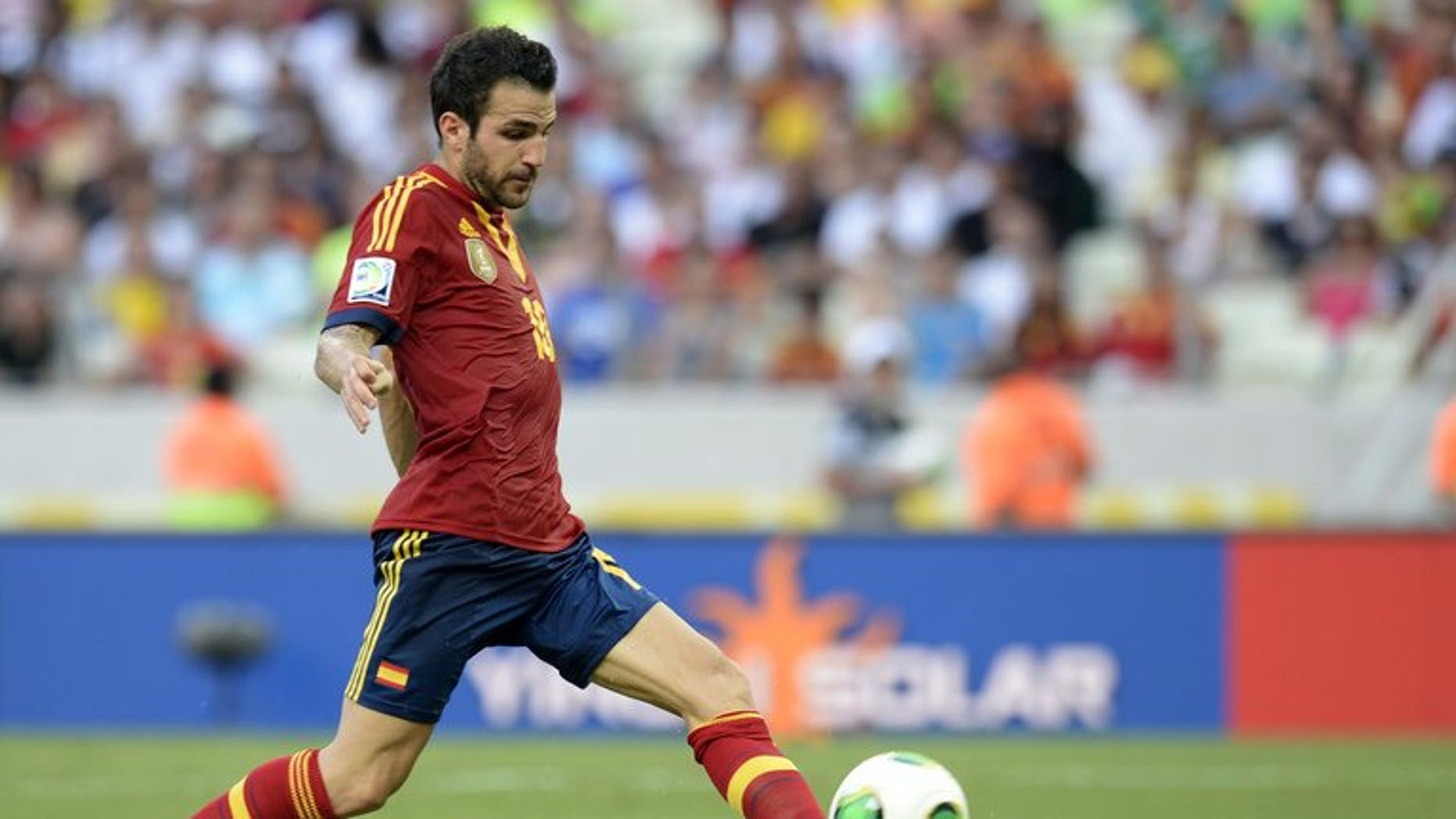 Spain's midfielder Cesc Fabregas drives the ball during a FIFA Confederations Cup Brazil 2013 match against Nigeria at the Castelao Stadium in Fortaleza on June 23, 2013. Manchester United have made a ??25 million ($37.7 million, 28.9-million-euros) offer for Fabregas, reports in the media suggested.