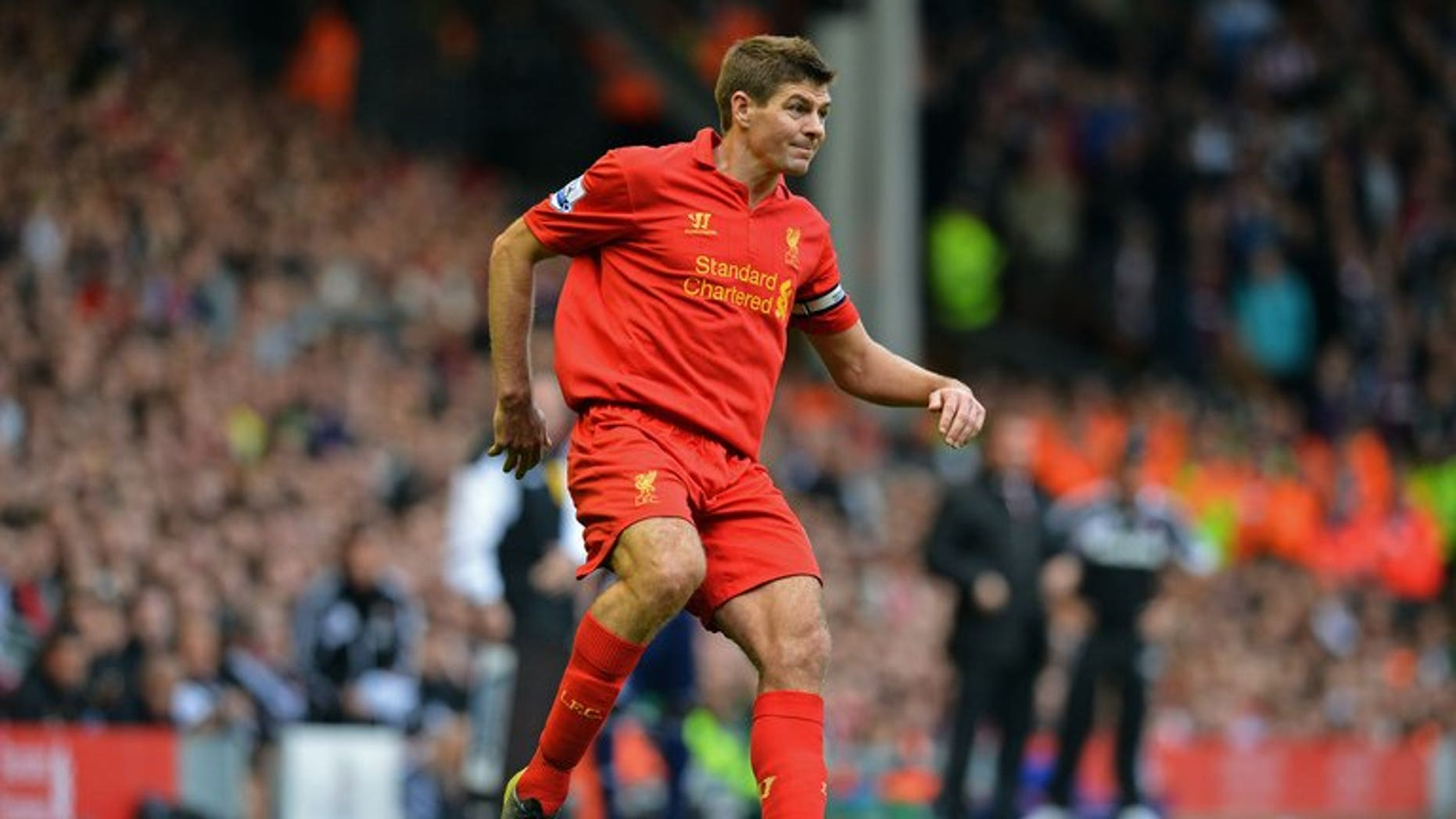 Liverpool midfielder Steven Gerrard controls the ball during a Premier League match against Stoke City at Anfield in Liverpool on October 7, 2012. Gerrard signed a new two-year contract extension with the only club he has ever played for.