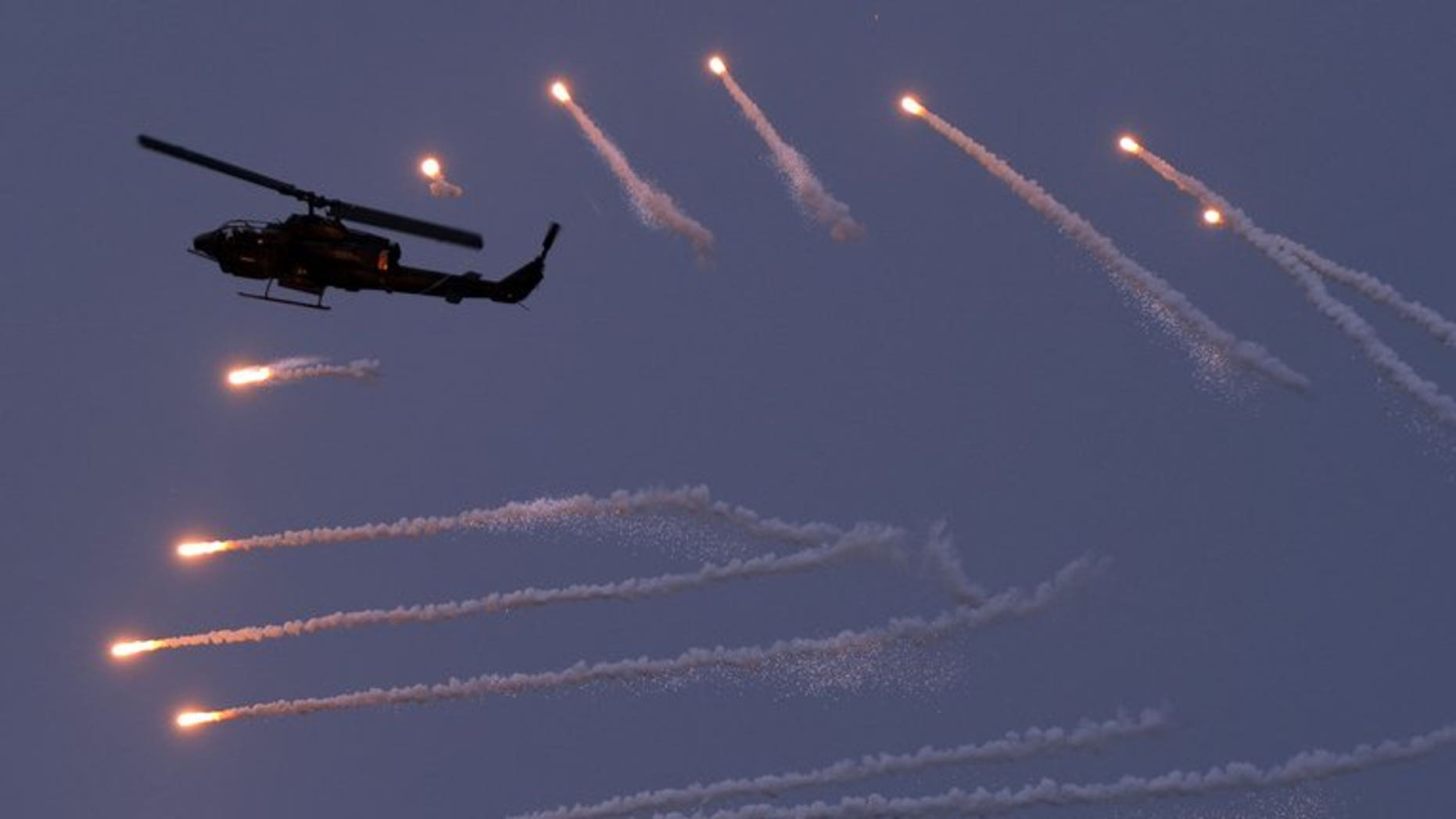 A AH-1W helicopter releases flares in a military drill in the western Penghu islands, on April 17, 2013. Taiwan has started a computerised military drill, set against an imagined scenario in which China invades the island in 2017.