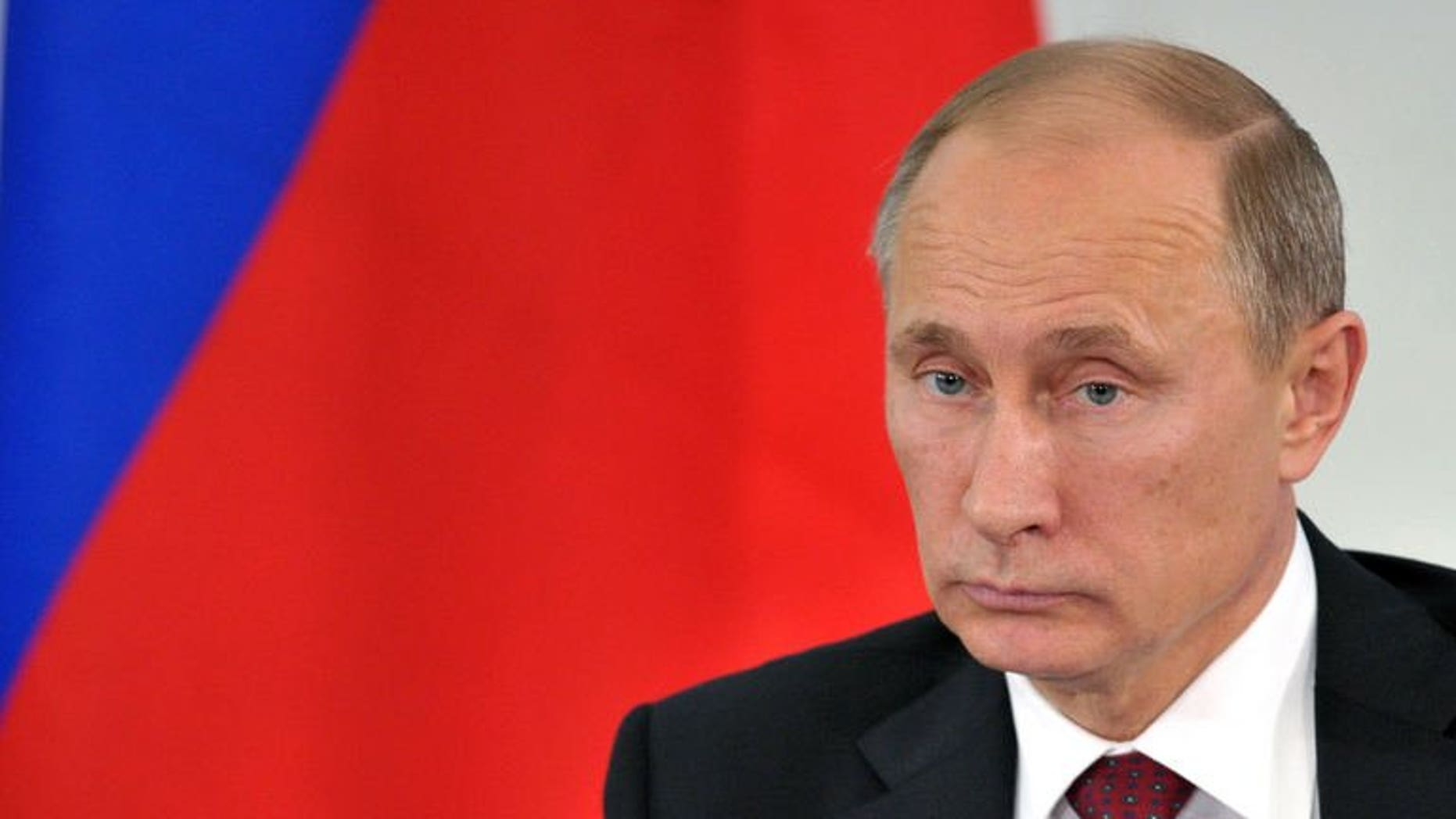 Russian President Vladimir Putin attends a press conference in Prokhorovka, on July 12, 2013. Putin has said US intelligence leaker Edward Snowden -- who has been stuck in a Moscow airport for three weeks -- would leave Russia as soon as he is able.