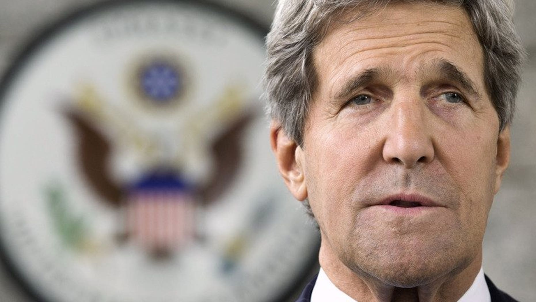 US Secretary of State John Kerry makes a statement to the press at the US Embassy in Bandar Seri Begawan on July 2, 2013. Kerry will return to the Middle East this week to push for Israel-Palestinian peace talks and will meet Mahmud Abbas.