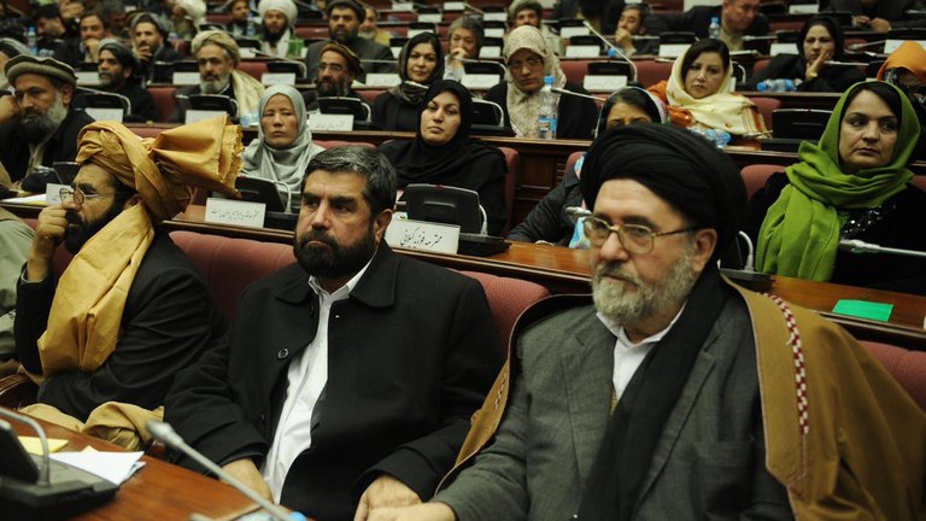 Afghan lawmakers attend a parliamentary session in Kabul, on January 2, 2010. The MPs have passed a bill to give the country's controversial electoral complaints watchdog more power and independence for the upcoming elections.