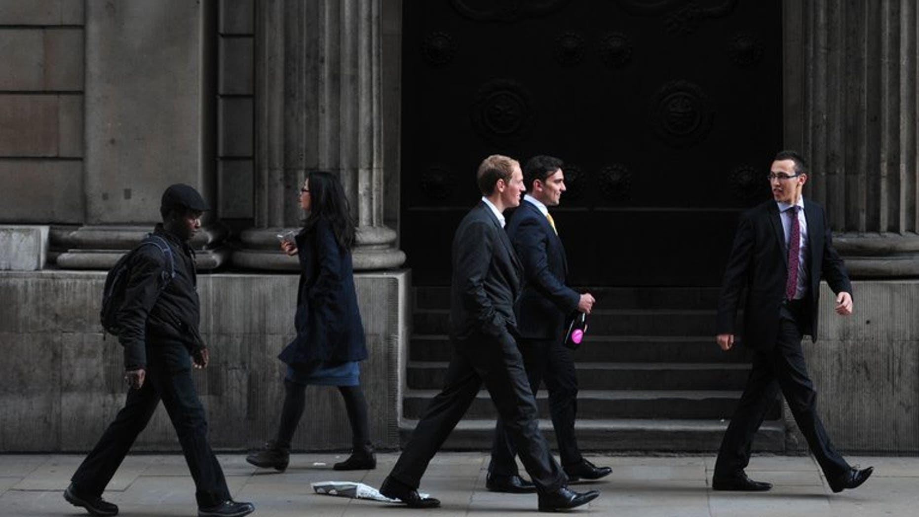 People walk past the Bank of England in the City of London on September 28, 2012. Britain's Serious Fraud Office said Monday that two former brokers have been charged with conspiring to manipulate the Libor interbank lending rate.