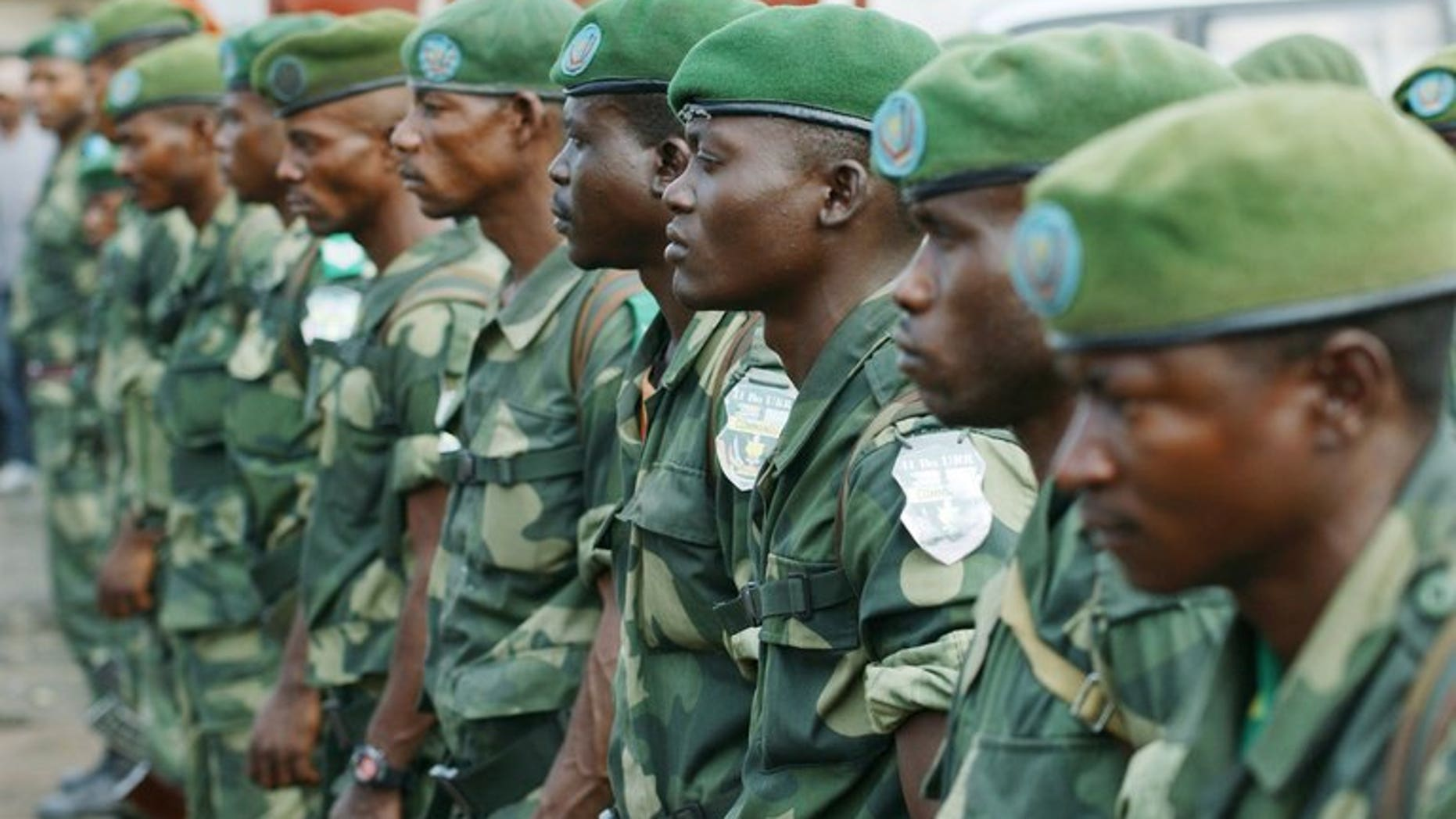 DR Congo's national army FARDC soldiers stand in formation in Karisimbi, south of Goma, on May 27, 2013. Rwanda's military spokesman said two mortar bombs were fired into the country from neighbouring DR Congo on Monday, blaming the DRC army - the FARDC - and the UN force MONUSCO.