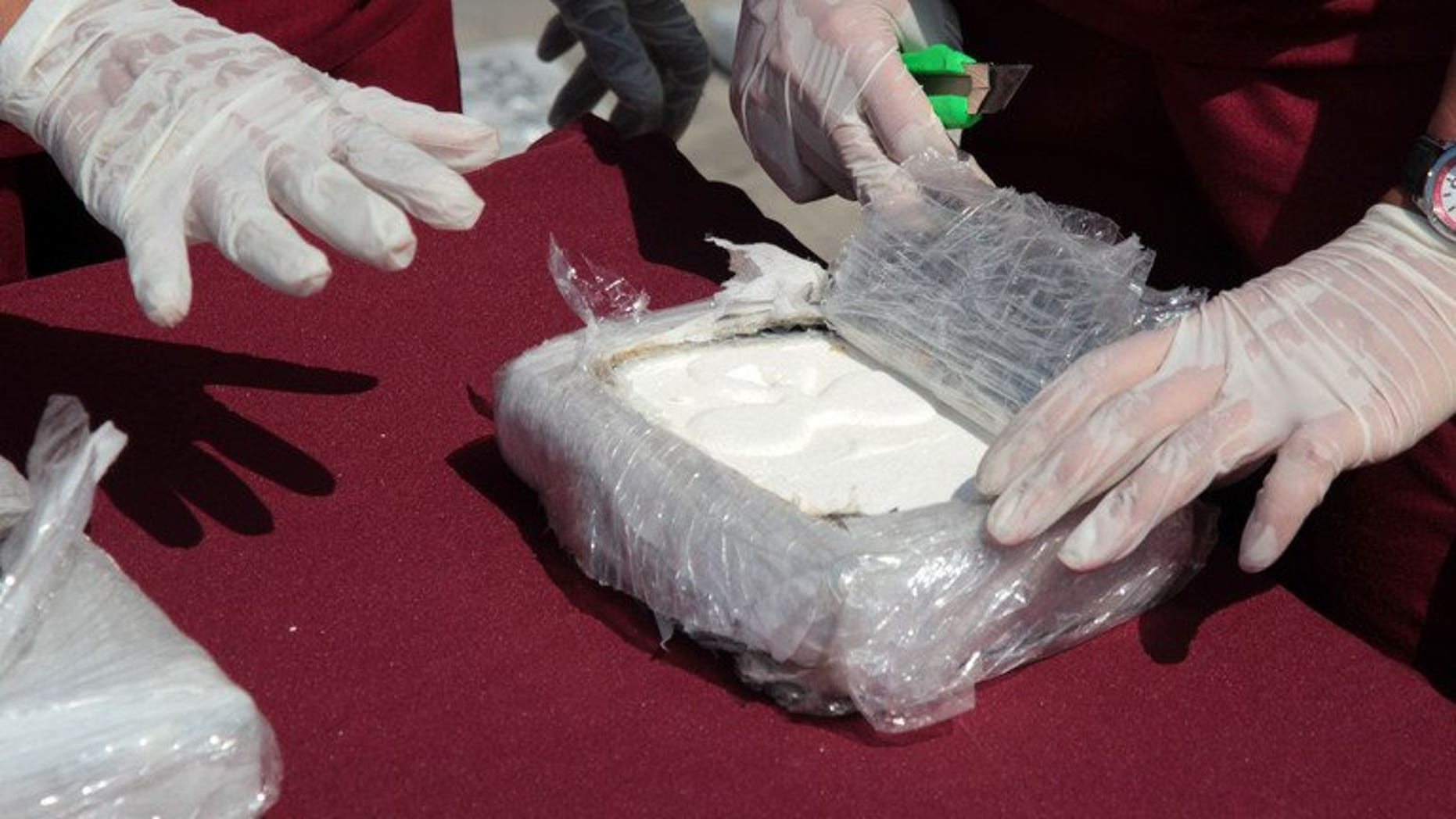 Criminology specialists test cocaine seized in Maracaibo, Zulia state, Venezuela, on April 25, 2013. Spanish police said Monday they had arrested a notorious British drug dealer, Brian Charrington, whom they accused of running an international trafficking racket involving cocaine from Venezuela.