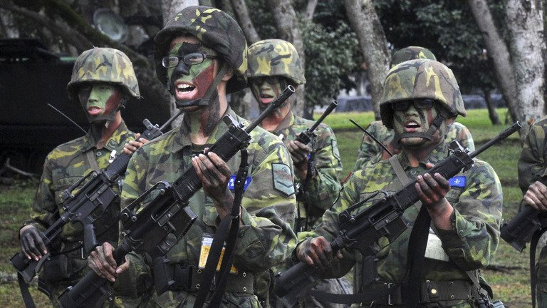 This file photo shows soldiers practising during a training session at the Hualien army base, on January 23, 2013. Taiwan's defence minister has apologised for the death of a corporal from heatstroke as the island's top government watchdog launches an investigation into bullying in the military, officials said on Tuesday.