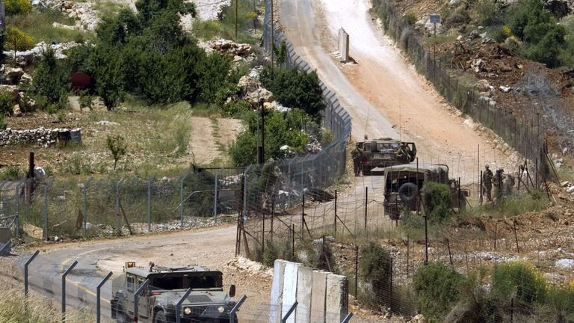 Israeli soldiers patrol the border fence between the Golan Heights and Syria next to the Druze village of Majdal Shams, on June 3, 2011. The Israeli military has confirmed that mortar fire from inside war-torn Syria landed in the Golan Heights.
