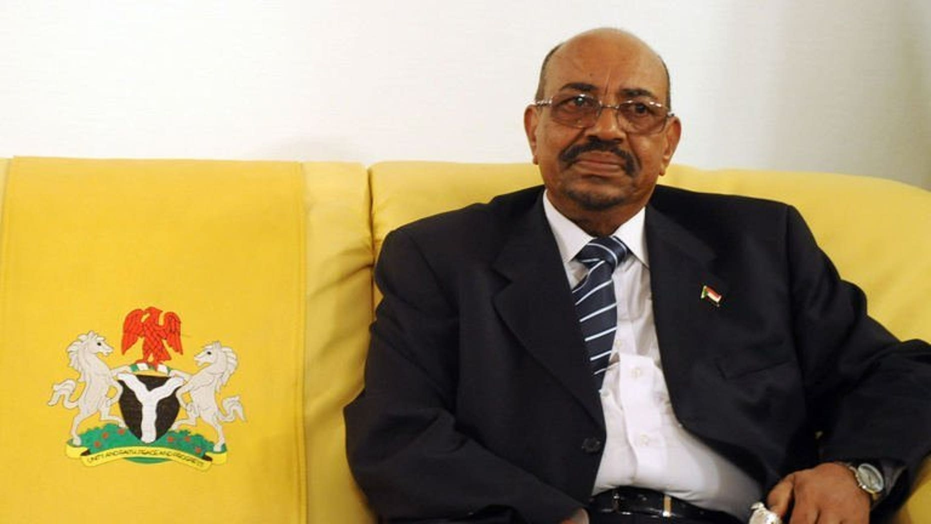 Sudan's President Omar al-Bashir pictured at Nnamdi Azikiwe International Airport in Abuja, Nigeria on July 14, 2013. Bashir has left Nigeria after demands for his arrest on war crimes charges, an embassy spokesman said Tuesday, though he denied his departure was due to the controversy.