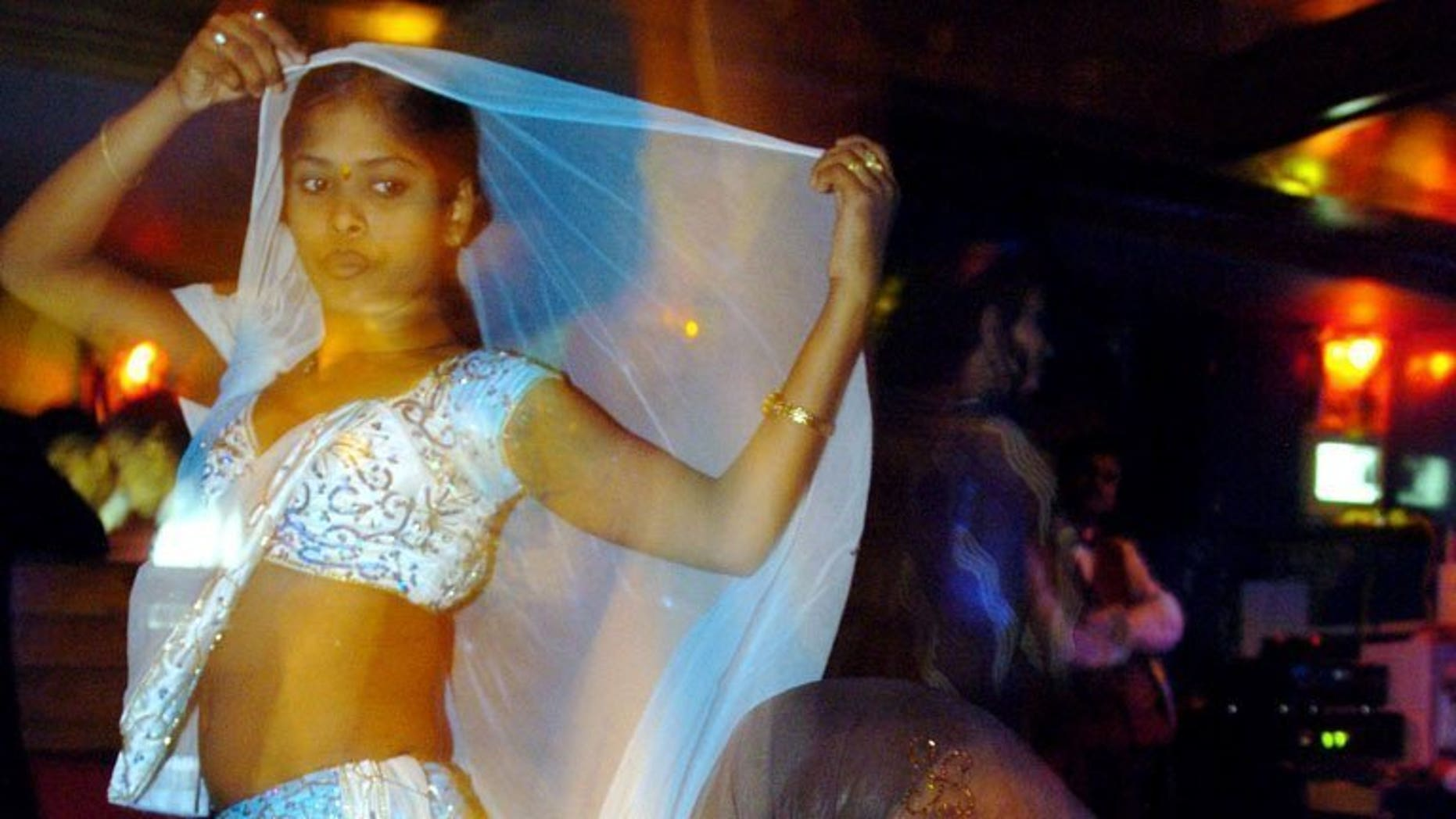 File picture shows bar dancers performing during their evening show in Mumbai, on May 6, 2005. India's top court on Tuesday overturned a ban on dance bars in the city of Mumbai, allowing hundreds of premises which employed women to dance and entertain customers to reopen.