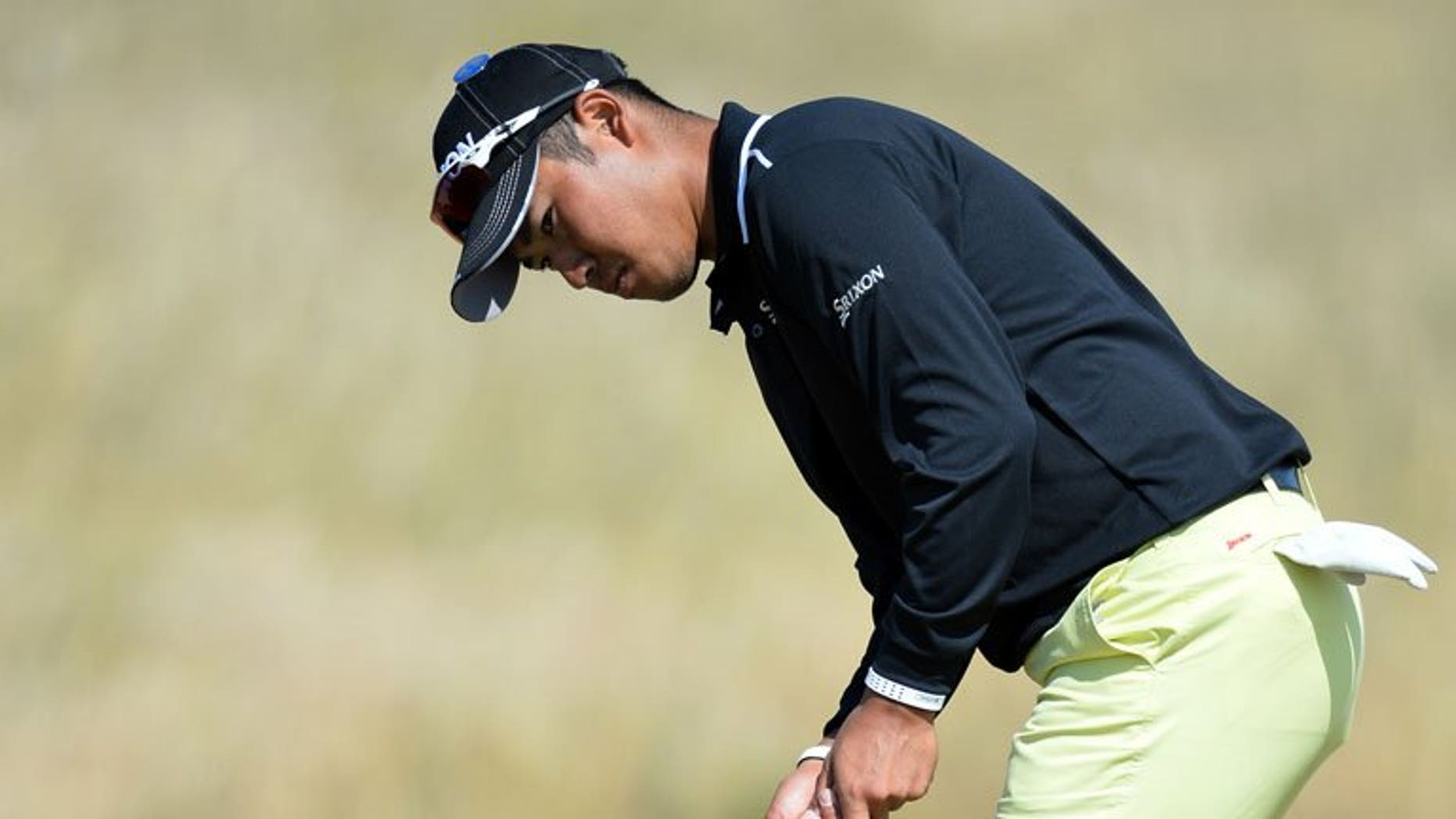 Japan's Hideki Matsuyama putts on the seventh green at Muirfield golf course in Scotland, on July 15, 2013. Matsuyama has sought out the advice of veteran compatriot Shigeki Maruyama to help him prepare for his British Open debut at Muirfield this week.