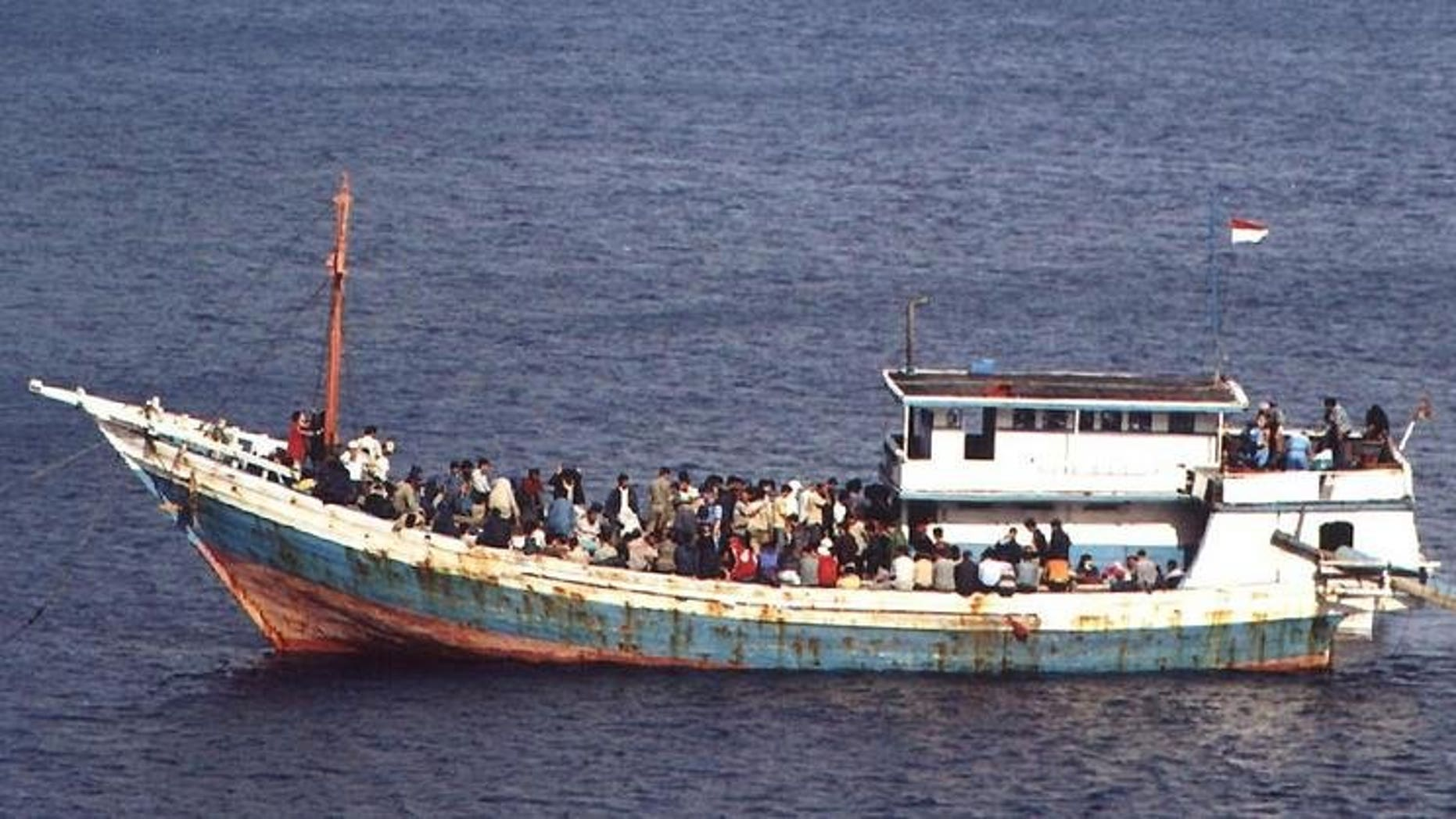 A boat carrying asylum seekers is intercepted by the Austalian navy on October 20, 2001. A boat carrying some 150 asylum-seekers capsized off Christmas Island Tuesday but the Australian navy saved most of them, rescuers said.