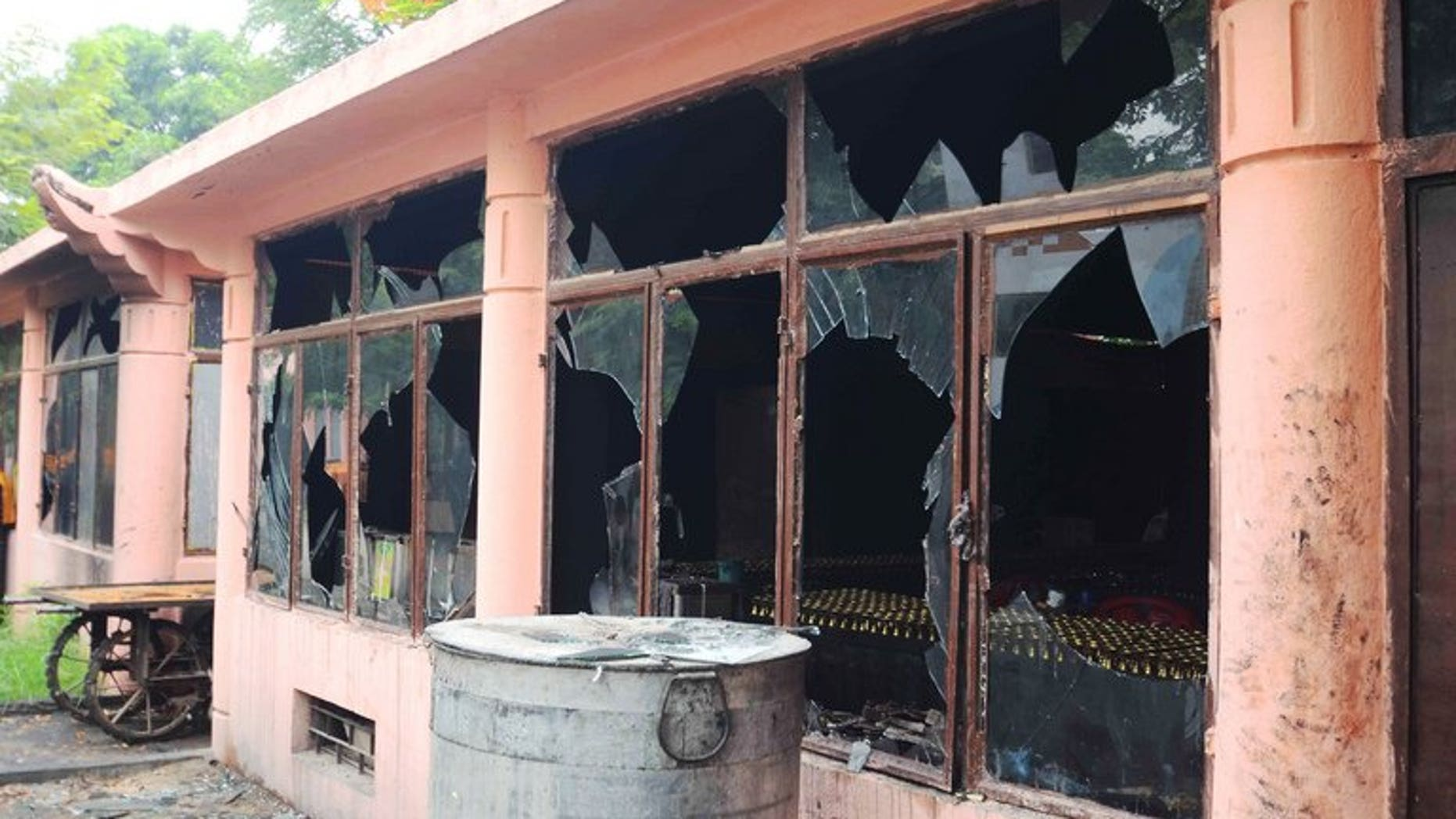 Broken windows at the Bodh Gaya Buddhist temple complex after several explosions took place on July 7, 2013. Indian police investigating bomb blasts at one of Buddhism's holiest sites released sketches of a suspect on Tuesday and offered a reward for information about the attacks.
